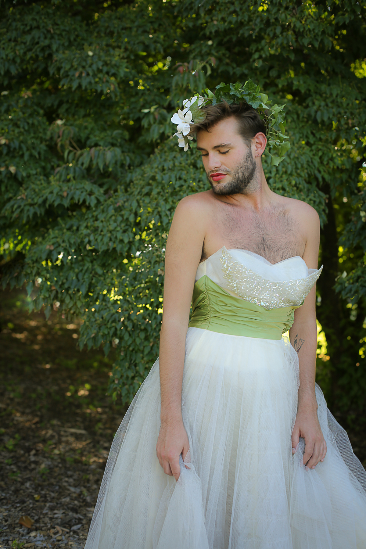 Beautiful man wearing a 1950s prom dress from Bride of the Fox Vintage on Etsy. Creative Portrait Photography by Blacksburg Virginia Photographer Holly Cromer.