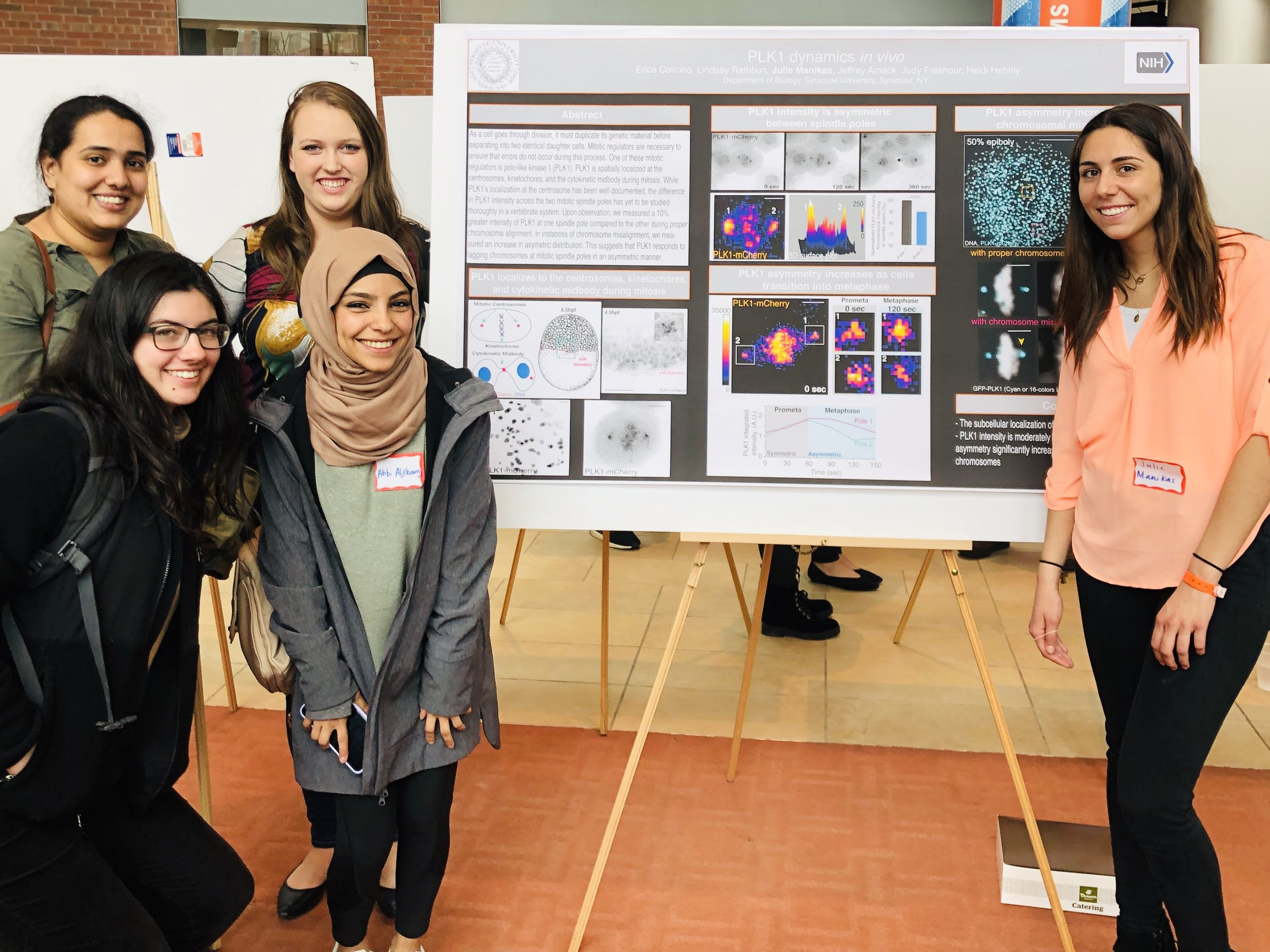 Shown are Nikhila, Erin, Jess, and Abrar at Julie's poster!