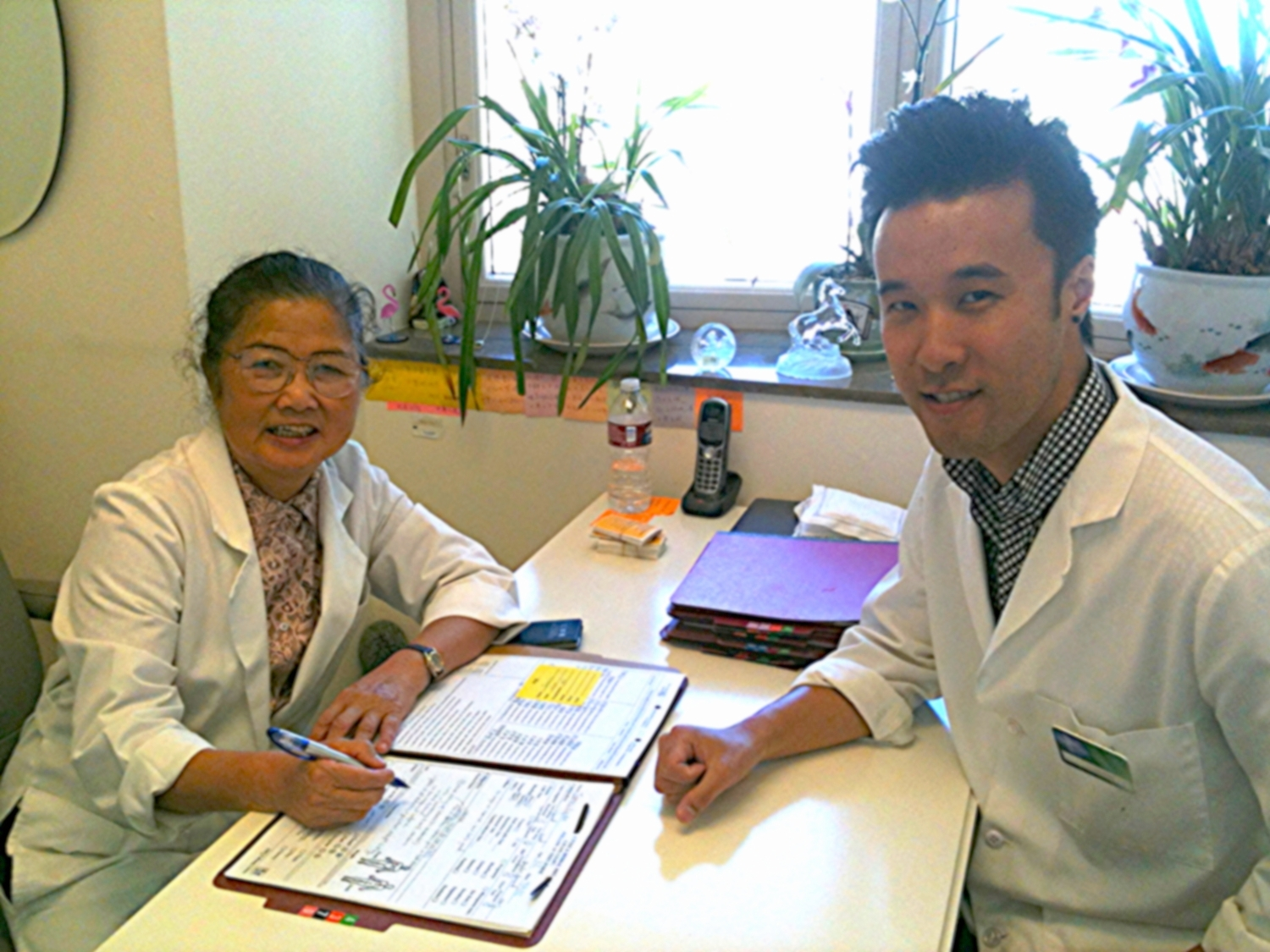 Wylie Huey, L.Ac. (right) is pictured here in 2009 with now-retired fertility expert Dr. Lifang Liang.