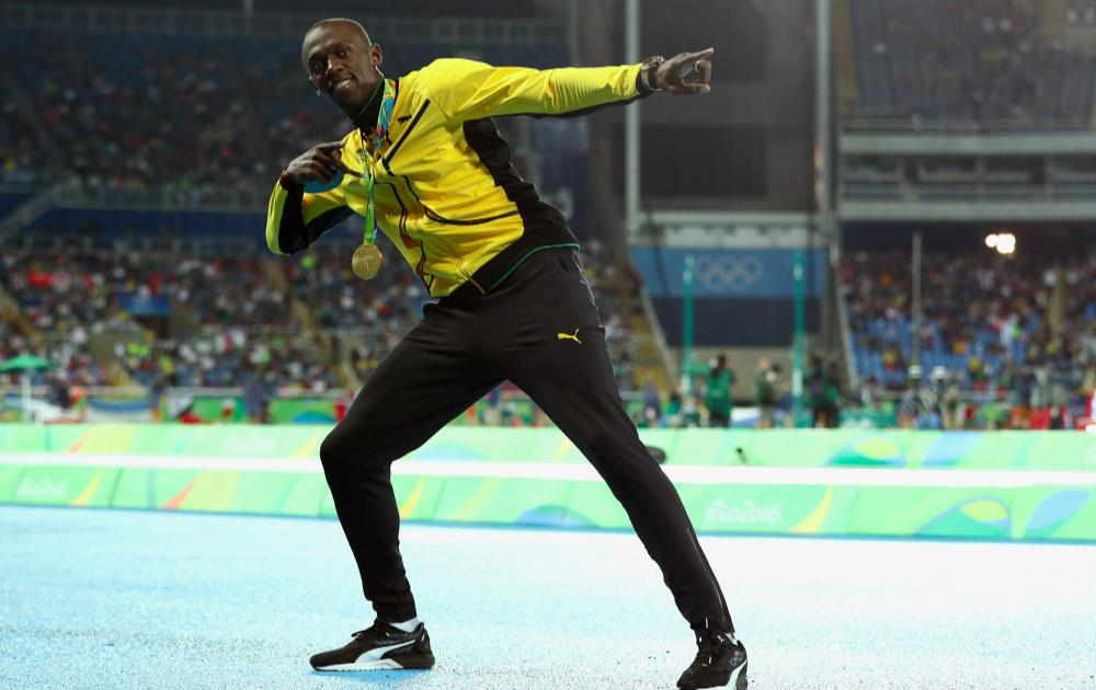 Usain Bolt of Jamaica - Winning Gold 200m [Source: Patrick Smith/Getty Images]