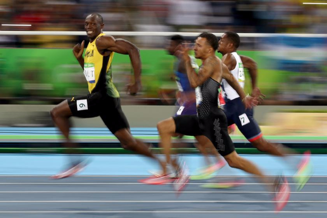 Usain Bolt of Jamaica - Winning Gold 100m [Source: Cameron Spencer/Getty Images ]