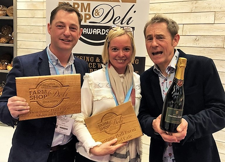 Rupert and Emma Evans from Denstone Hall Farm Shop and Café, which was crowned Best Large Farm Shop Retailer and was the overall winner of the Midlands region at the Farm Shop and Deli Awards, which were presented by food and drink broadcaster Nigel Barden (right). Penguin PR: public relations, media and communications