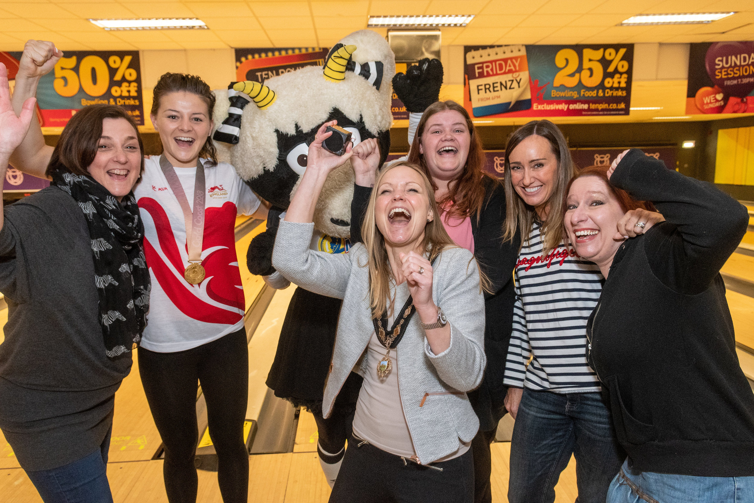 Juliette Whitby, wife of Mayor councillor John Whitby, celebrates her victory following the Mayor v Mayoress charity event at Tenpin Derby with Commonwealth gold medalist Sandy Ryan and Derby County mascot Ewie, plus members from charity Derbyshire Children's Holiday Home in Skegness. Penguin PR: Public relations, media and communications