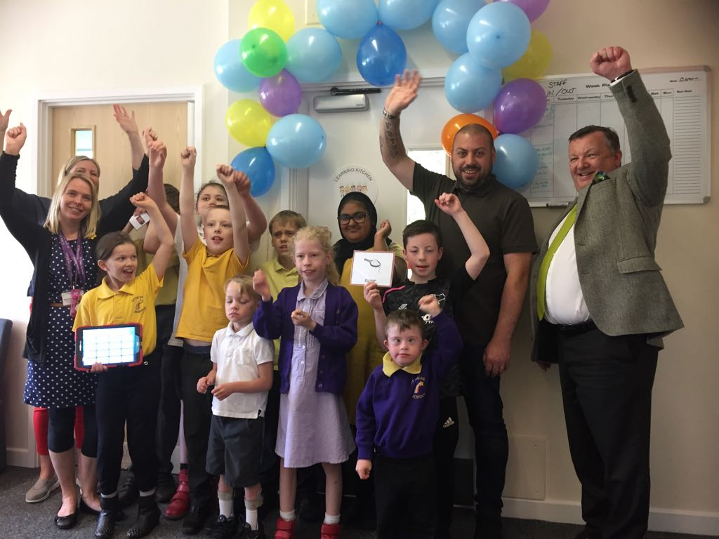 Pupils celebrate the opening of the brand-new Learning Kitchen at St Giles School in Derby. Penguin PR: public relations, press, media and communications