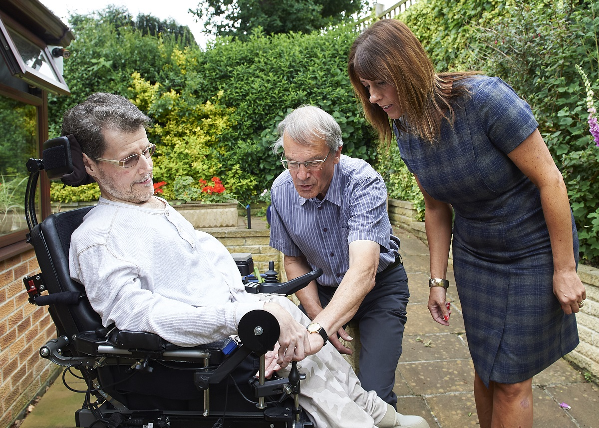From left, Richard Shaw, who has a muscle-wasting disease and has benefitted from the work of Remap, discusses a modification to his chair with Remap volunteer Mike Banks and Jane Spencer, secretary of Hazelwood chemical company Lubrizol's Charities and Community Committee.