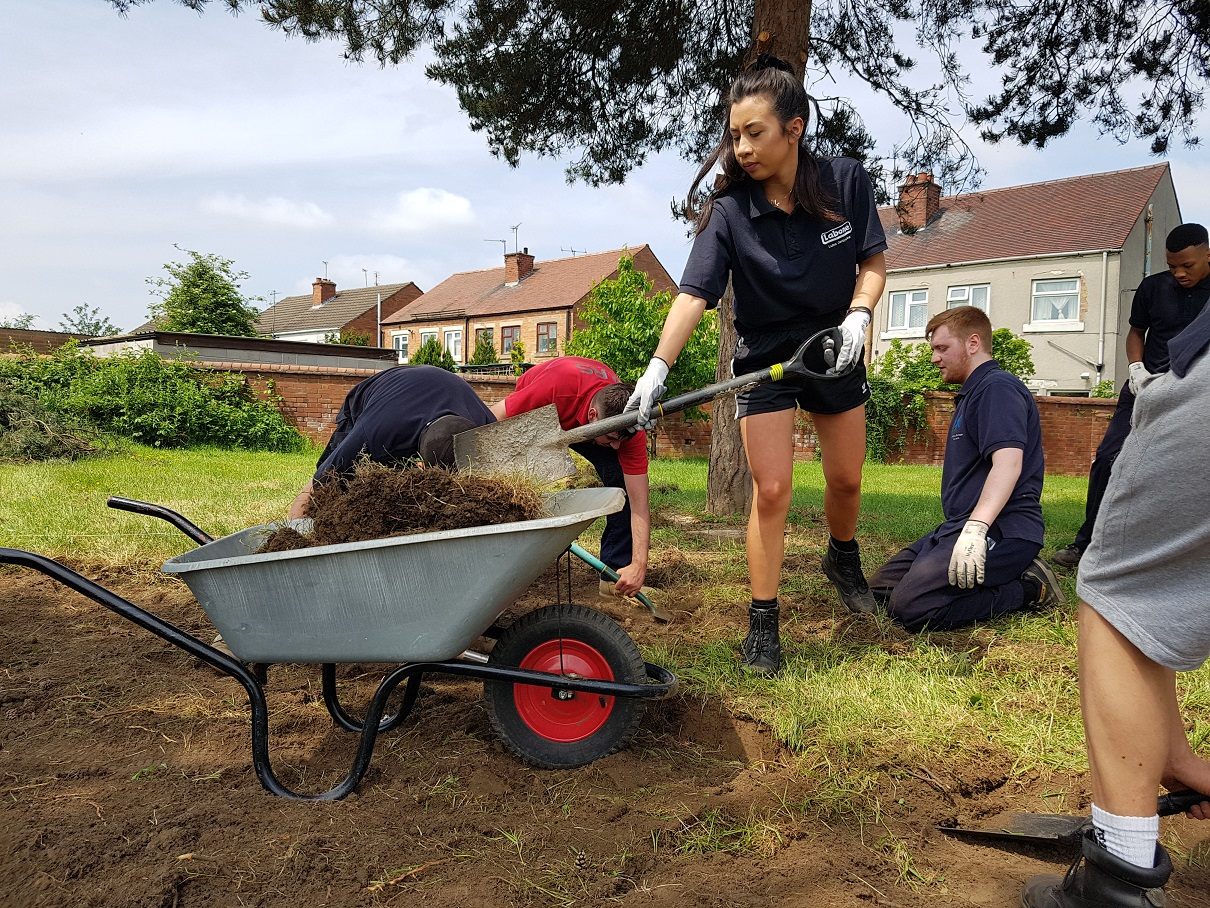 Toyota apprentices helped to create a garden at Kingsmead School. Penguin PR - public relations, media and communications