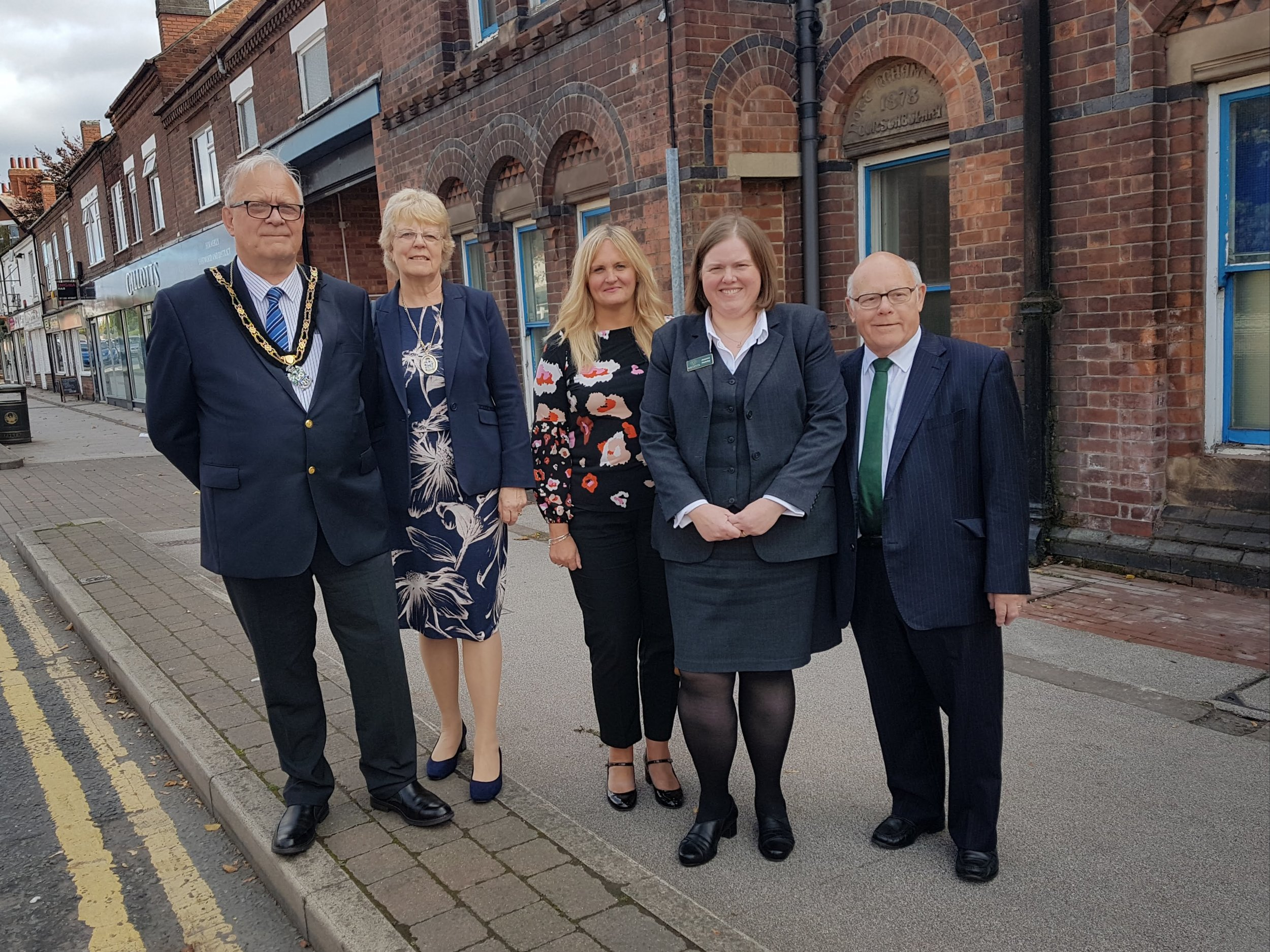 From left, Councillor Derek Burnett, Mayor of Broxtowe, his wife, Sonia, Tracy Turner, business manager at Barclays, and Joanne and Barry Hutsby, partners in Gillotts Funeral Directors, outside Eastwood Police Station, which Gillotts has bought to enable the company to expand its headquarters. Penguin PR: public relations, media and communications