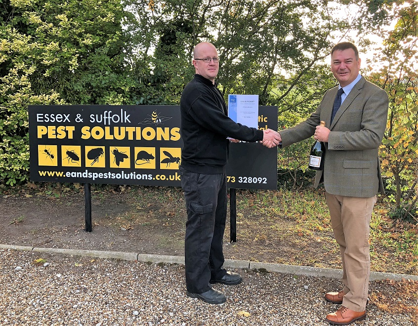 Steve Wilson, who works for Essex and Suffolk Pest Solutions, receives champagne from BASIS PROMPT chief exec Stephen Jacob after he became the 5,000th person to sign up to the register. Penguin PR: public relations, media and communications