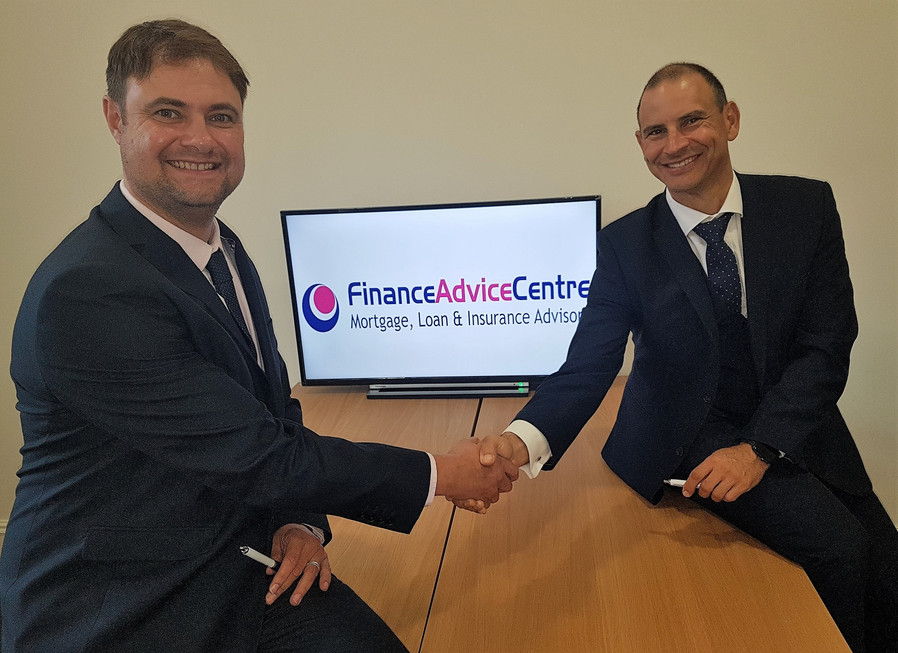 Picture shows: Dave Smit (left) shakes hands with Finance Advice Group's managing director Matt Cassar following the launch of the company's second Finance Advice Centre outlet in Ilkeston. Penguin PR: public relations, media and communications