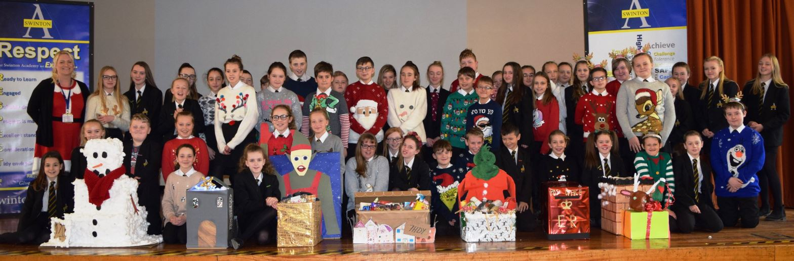 Year 7 pupils at Swinton Academy with their Christmas hampers, which will be distributed to local residents. Penguin PR: public relations, media and communications