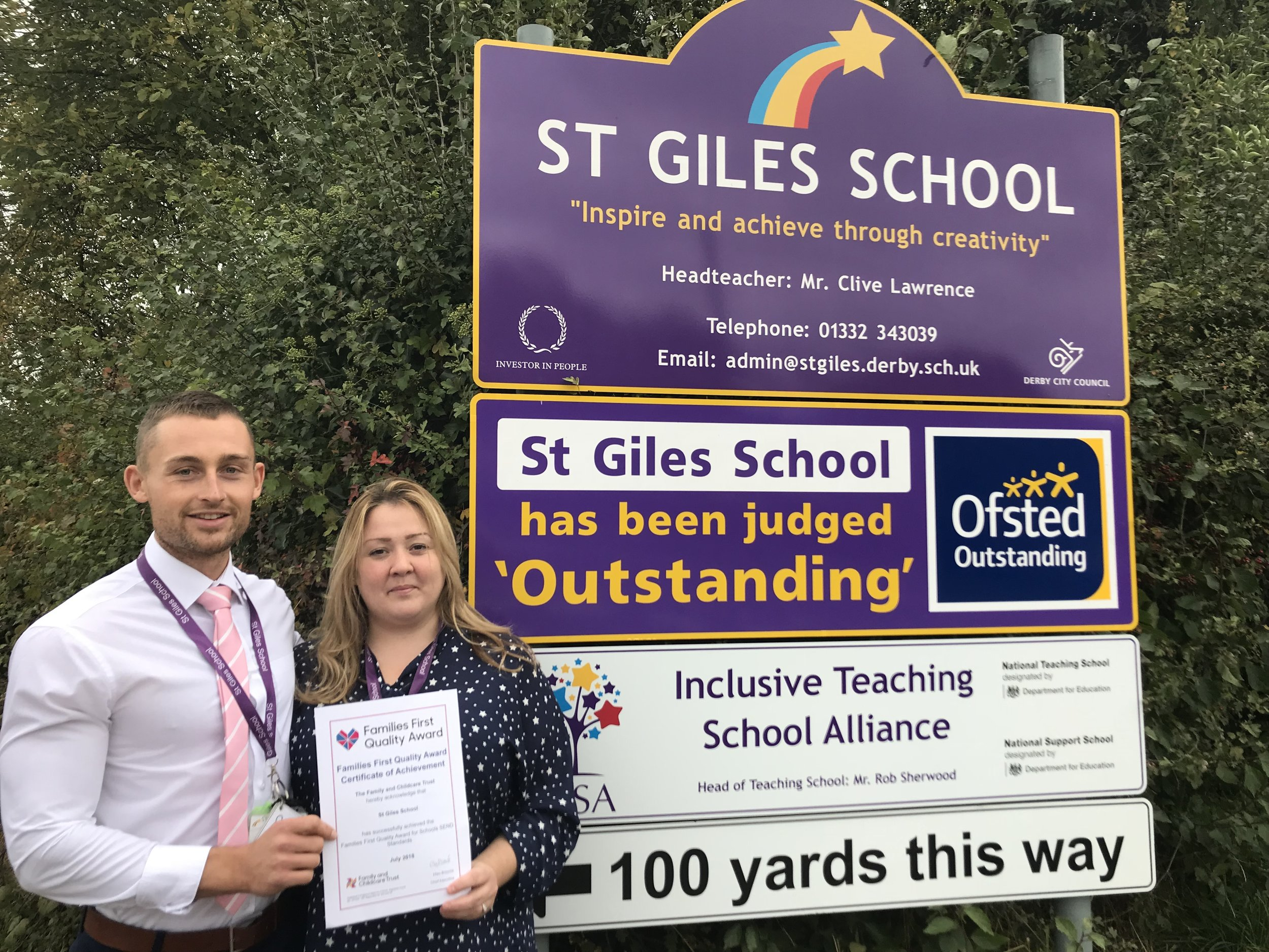 Sam Pryor and Fiona Hallam are pictured outside St Giles School in Derby with their Family First Award. Penguin PR: public relations, media and communications