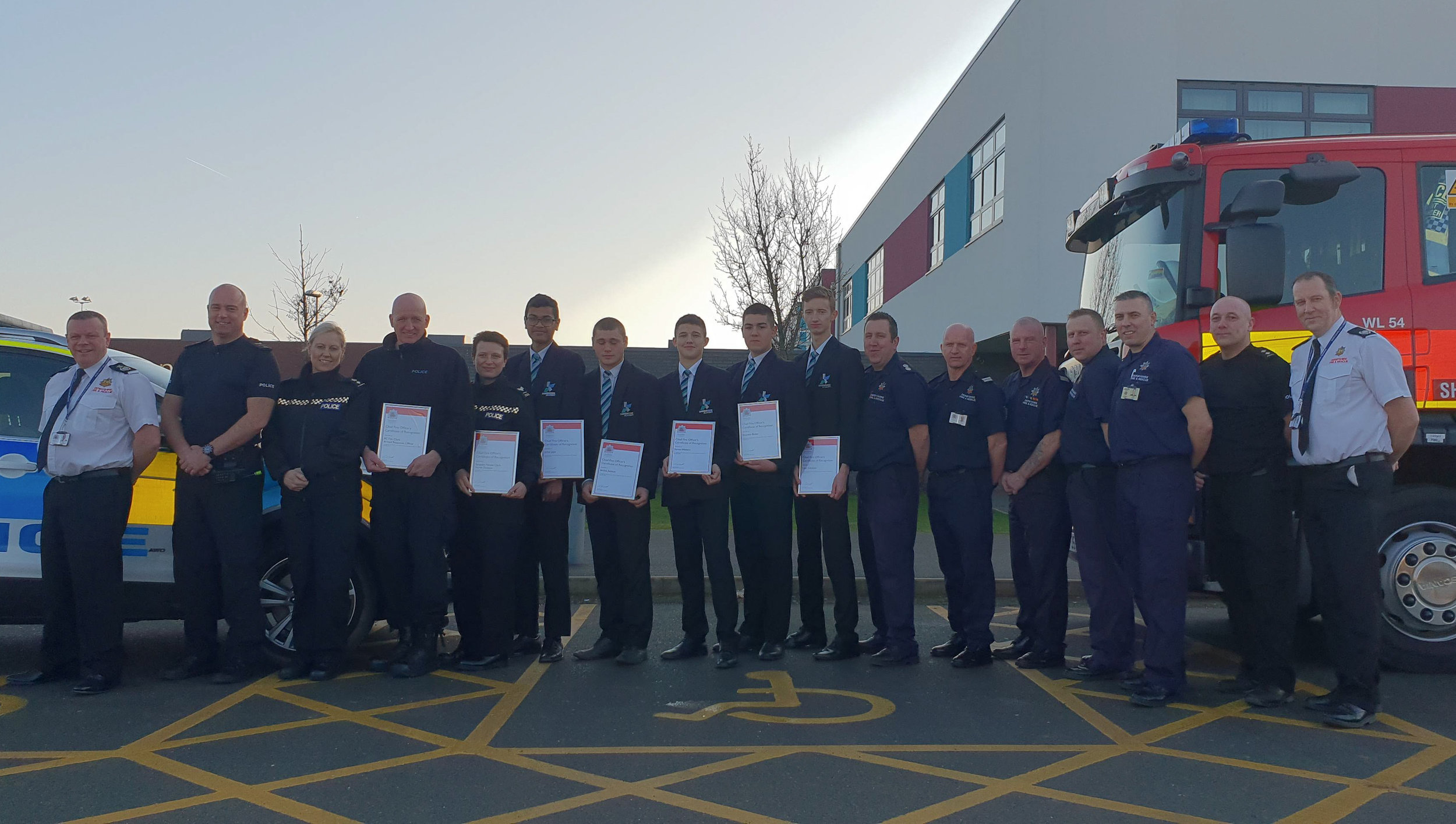 Members of the Derbyshire Police and Derbyshire Fire & Rescue Service with the five teenagers from Shirebrook Academy. Penguin PR: public relations, media and communications.