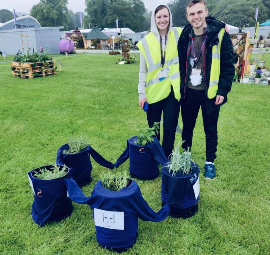 Anna Young and James Gough with the sensory planters made by pupils at St Giles School in Derby at the RHS Chatsworth Flower Show in Derbyshire. Penguin PR: public relations, media and communications