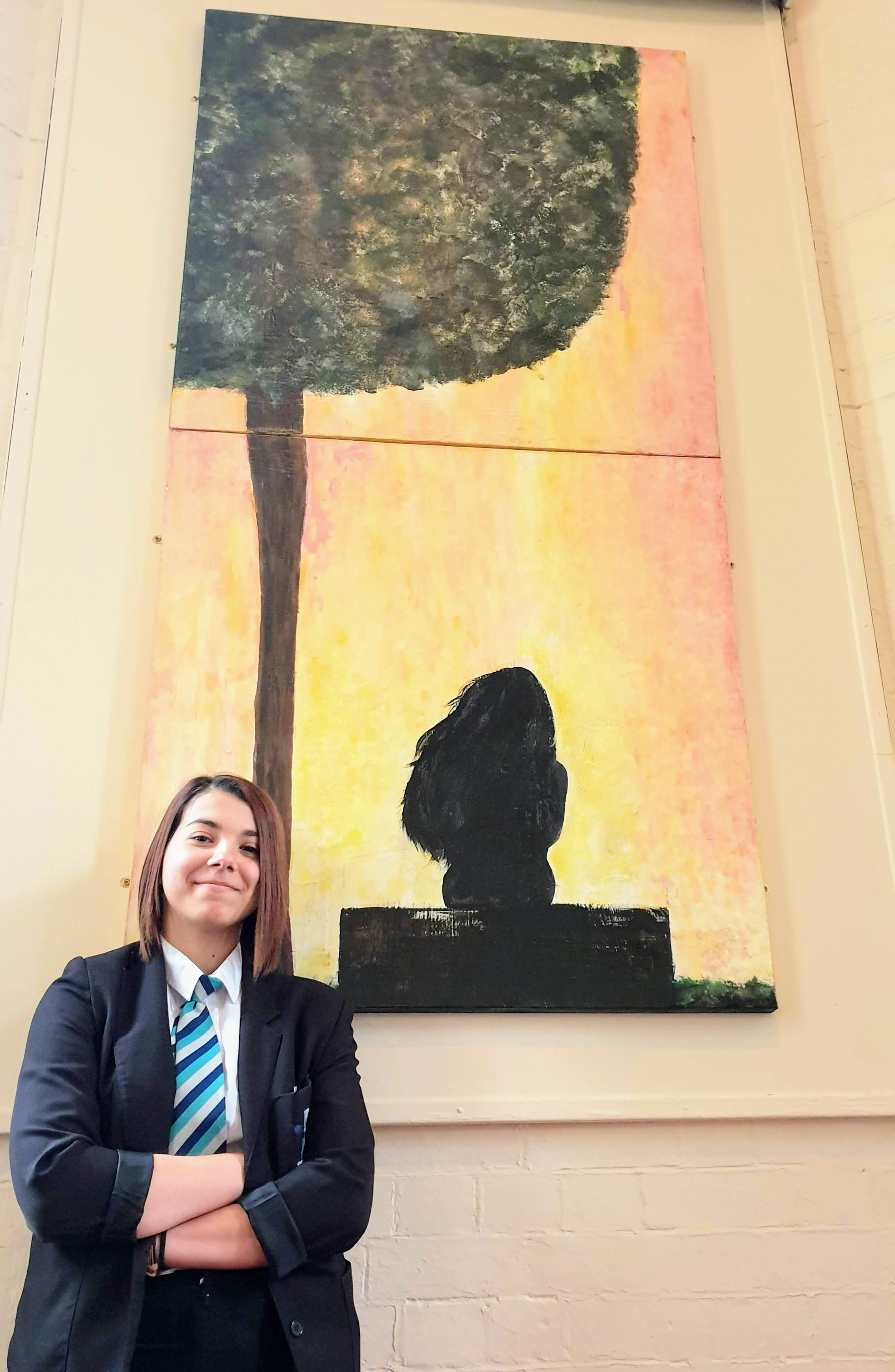 Student Ilona Esanu, 15, who attends Shirebrook Academy, has designed a new painting which has been given pride of place on the wall of Shirebrook's cemetery chapel as part of a restoration project. Penguin PR: public relations, media and communications.