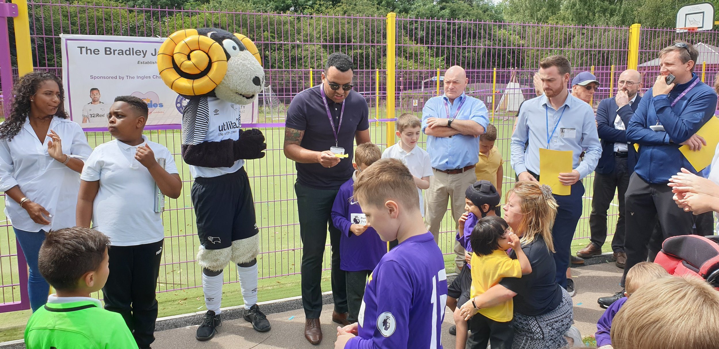 Derby County mascot Rammie with St Giles School executive head teacher Clive Lawrence at the opening of the MUGA.