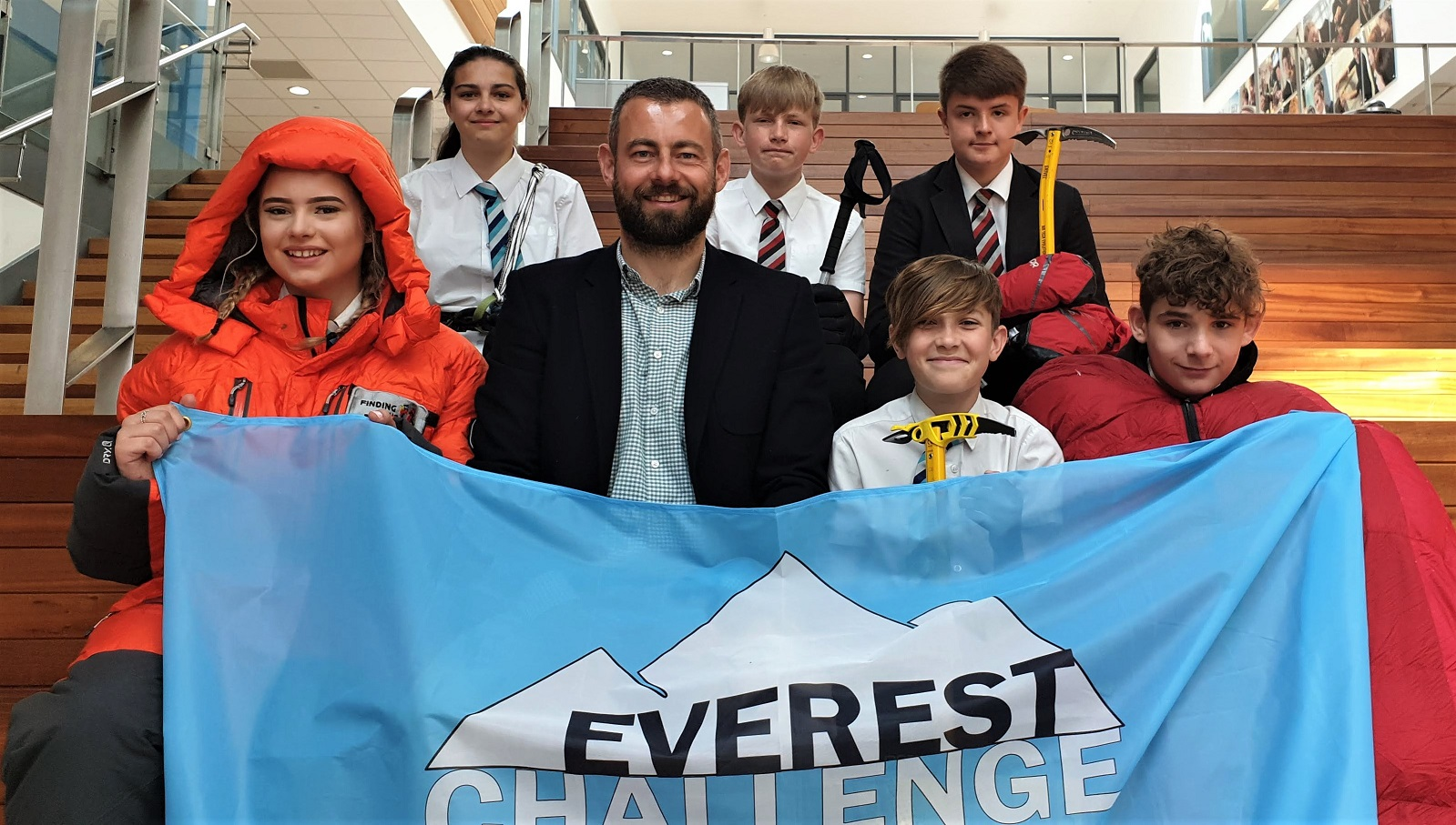 Everest climber Ricky Munday (centre) shared his expertise with Shirebrook Academy students (front row from left) Ellena Keigher, 15, Josh Towers, 14, and Josh Hutton, 14, and (back row) Reanna Davies, 15, Callum Nussey, 14, and Charlie Jones, 13. Penguin PR: public relations, media and communications