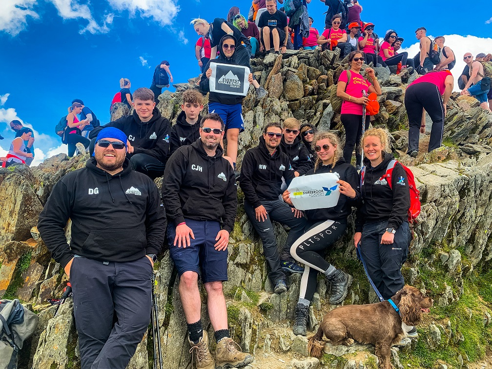 The Shirebrook Academy Everest Challenge team pictured at a very crowded summit of Snowdon, which they  conquered last month.