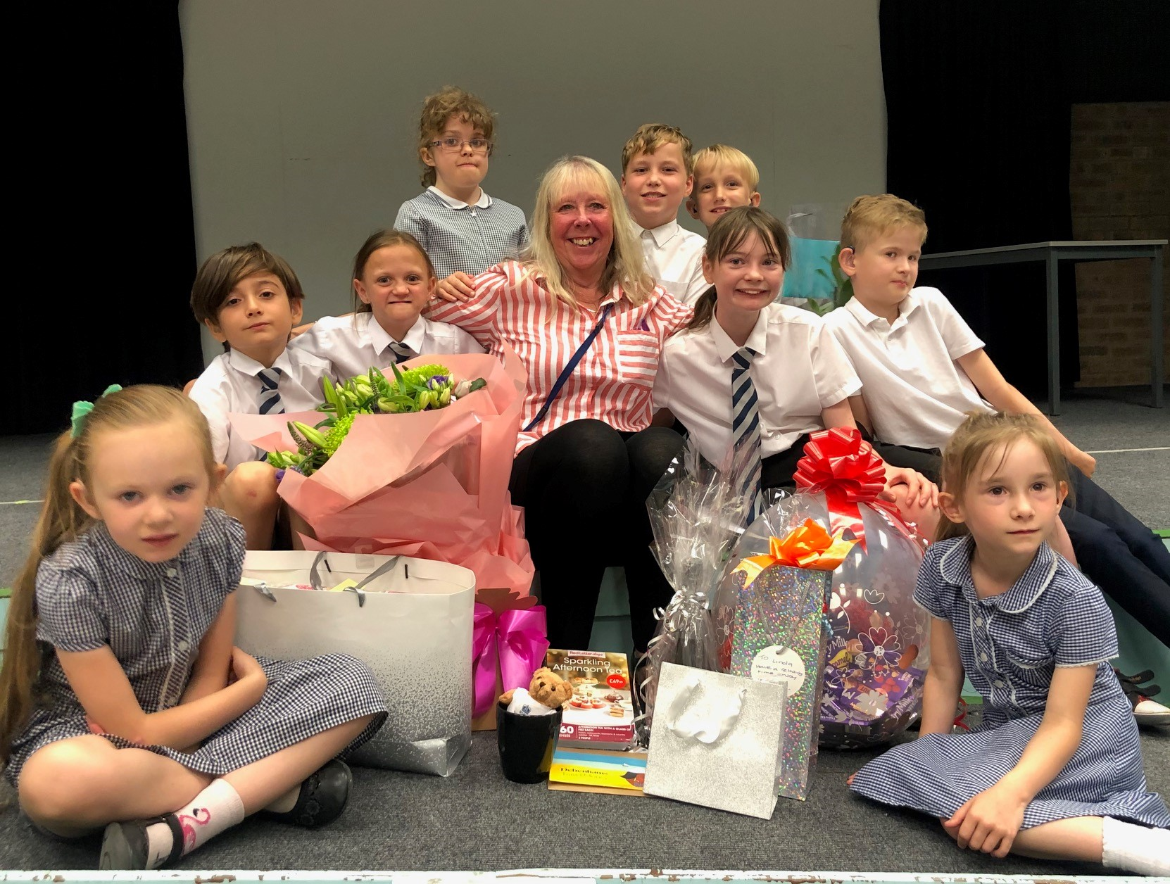 LInda Vessey is pictured with pupils from the Royal School for the Deaf Derby on her final day. Penguin PR: public relations, media and communications