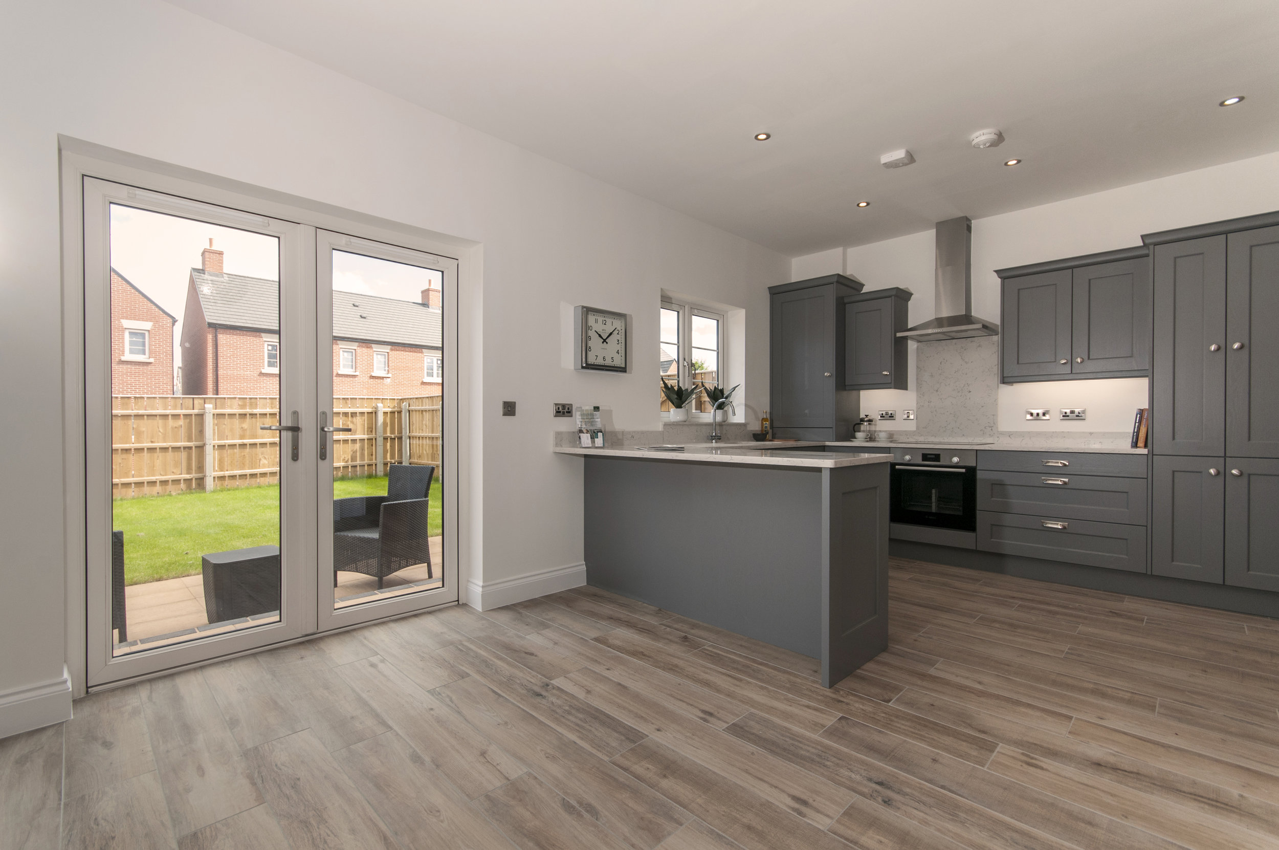 The kitchen in the Deer Park showhome has French doors which lead out to the garden. Each Deer Park home comes with freshly-laid turf as standard. Penguin PR: public relations, media and communications