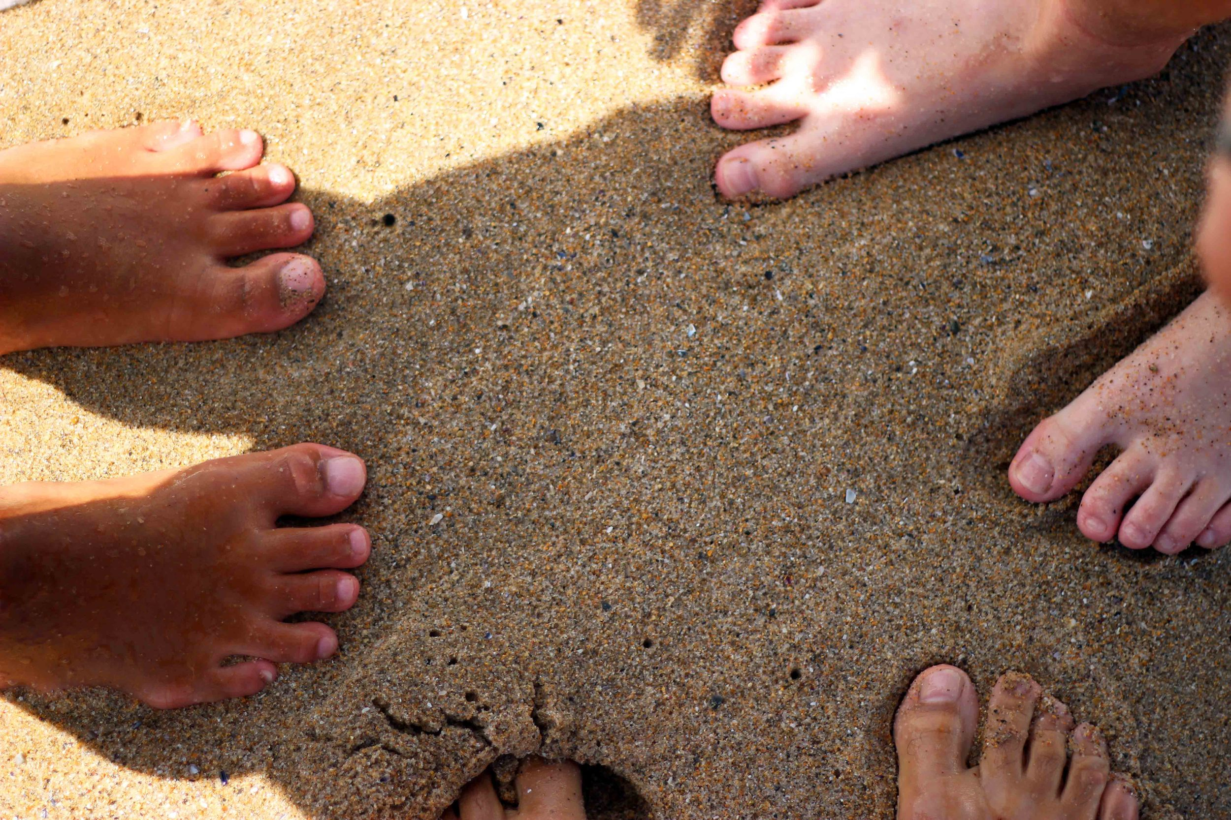 the unique feeling of being barefoot on a sandy beach