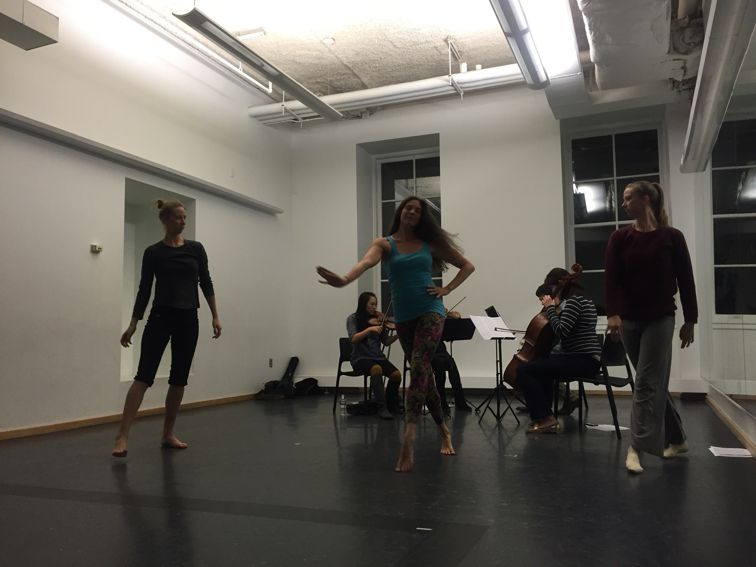 Hannah, Emily, and Gwen work with the string quartet during a Creative Session.