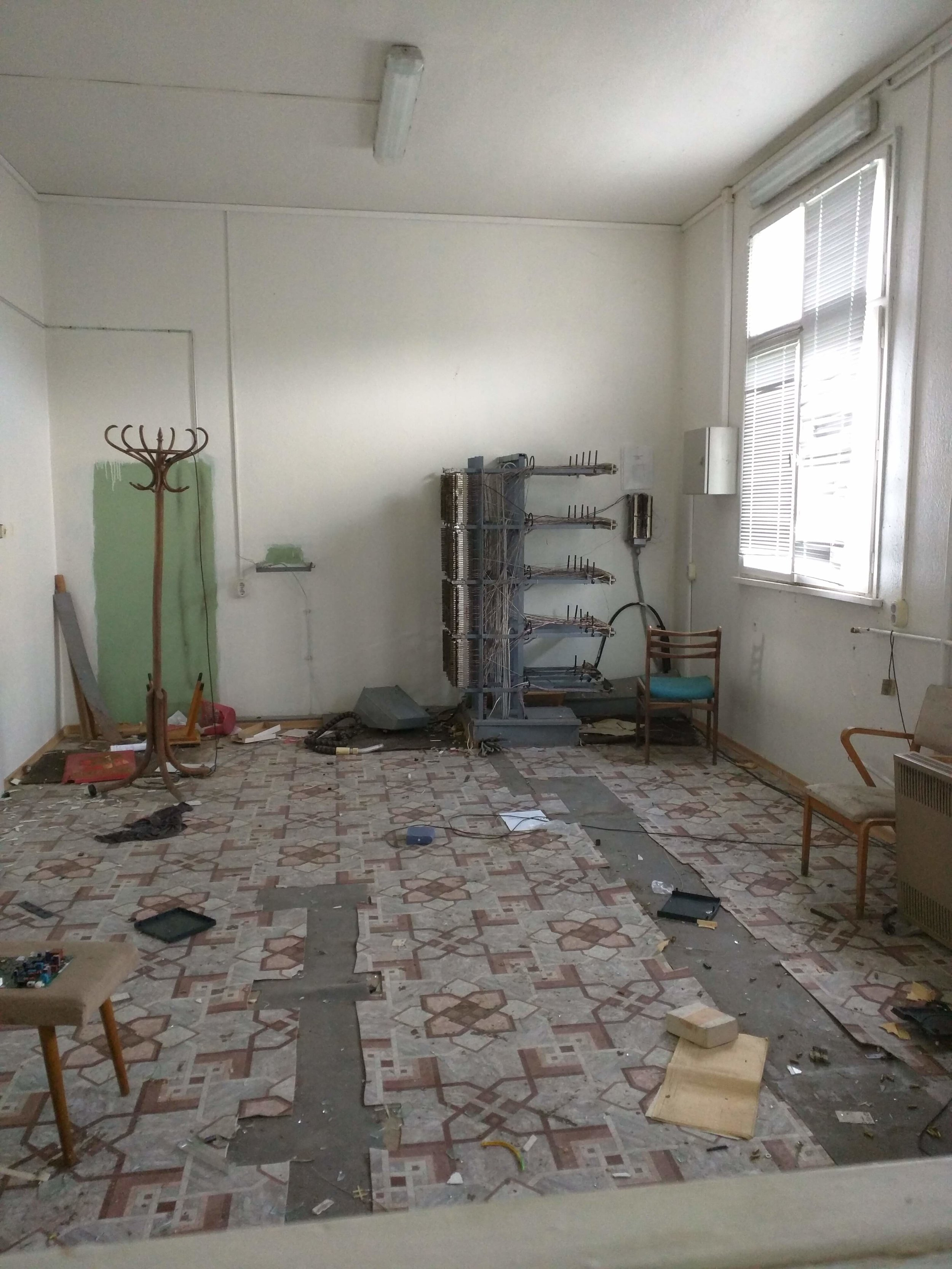 Abandoned room with telephone switchboard