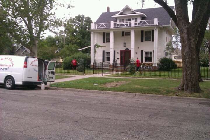 Power washing a house in Wichita, Kansas - Thomas Brothers Mobile Wash