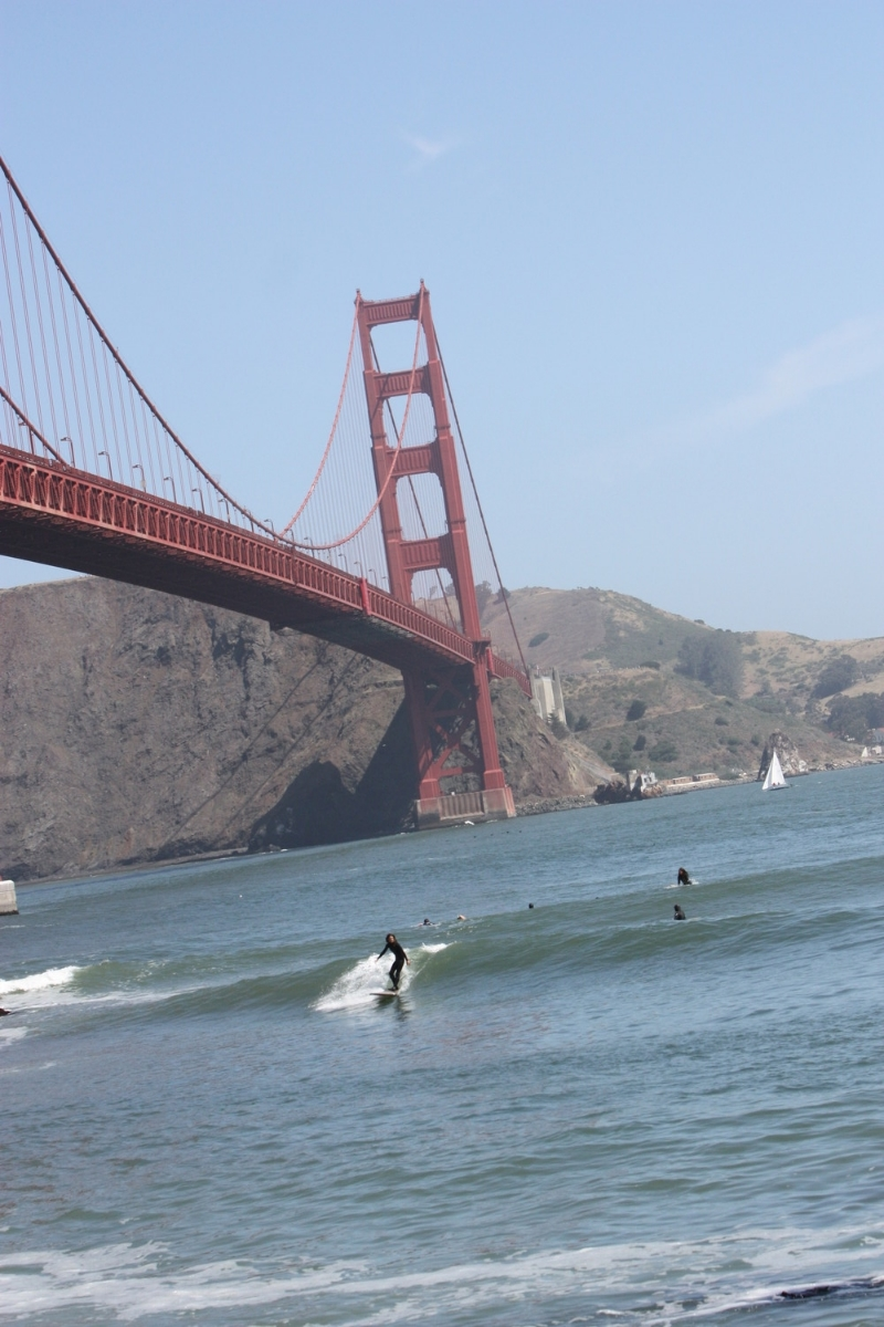Julie cruising on an inside wave at Fort Point.