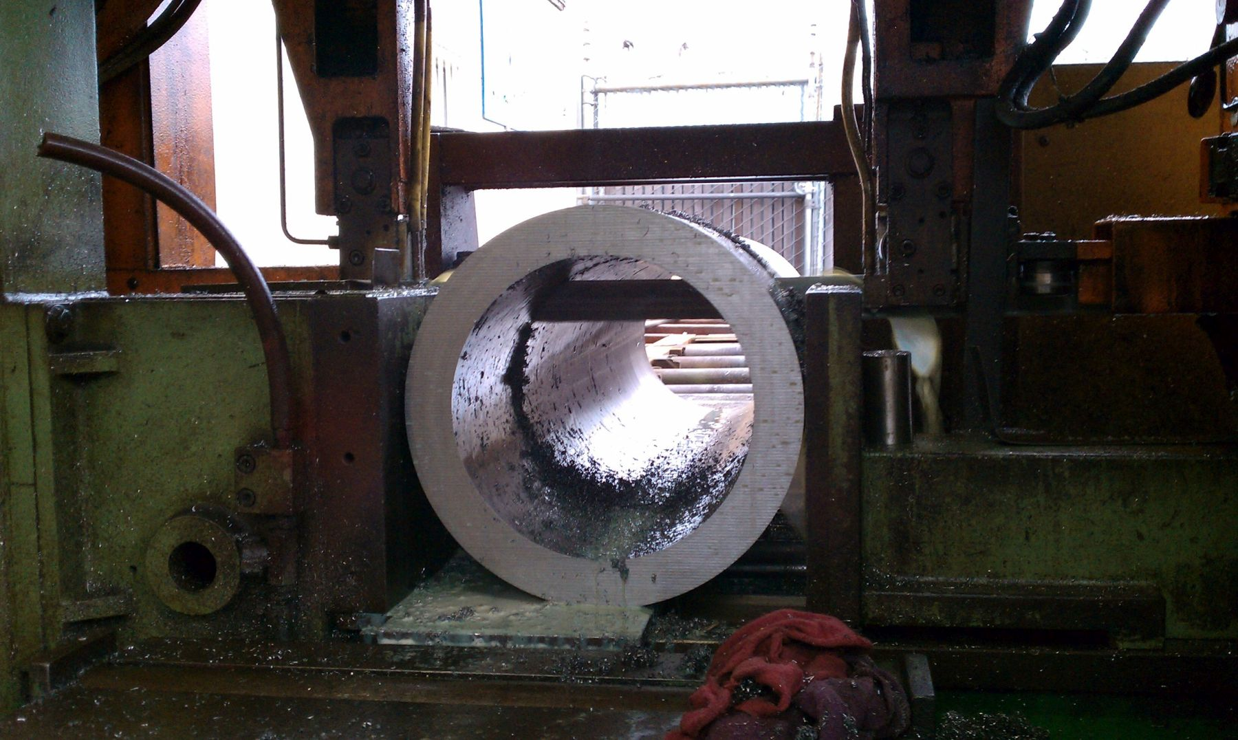 "Saw cutting 14"" OD, trepanned bar"