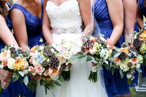 blue bridesmaid dresses and sash.jpg