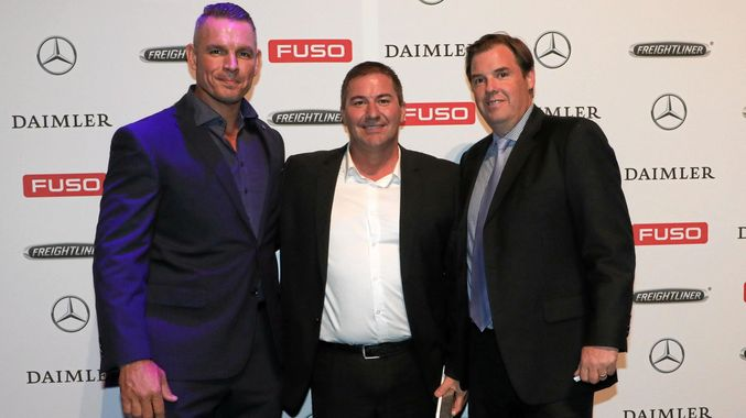 TOP DEALERS: (Left to right) RGM Maintenance Company Directors Greg Jackson and Russell Newman were presented the Daimler Truck and Bus Dealer of the Year award by Daimler Truck and Bus Australia Pacific President and CEO, Daniel Whitehead. Contributed