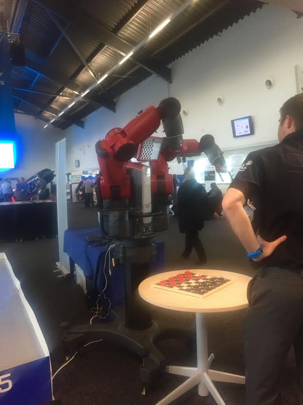 Laura Did battle with a huge Drafts playing Robot at the Mathworks Matlab Expo. It won not because it never sleeps, and never, ever, ever, stops until it's crushed you, but because the kids these days don't know how to play drafts.