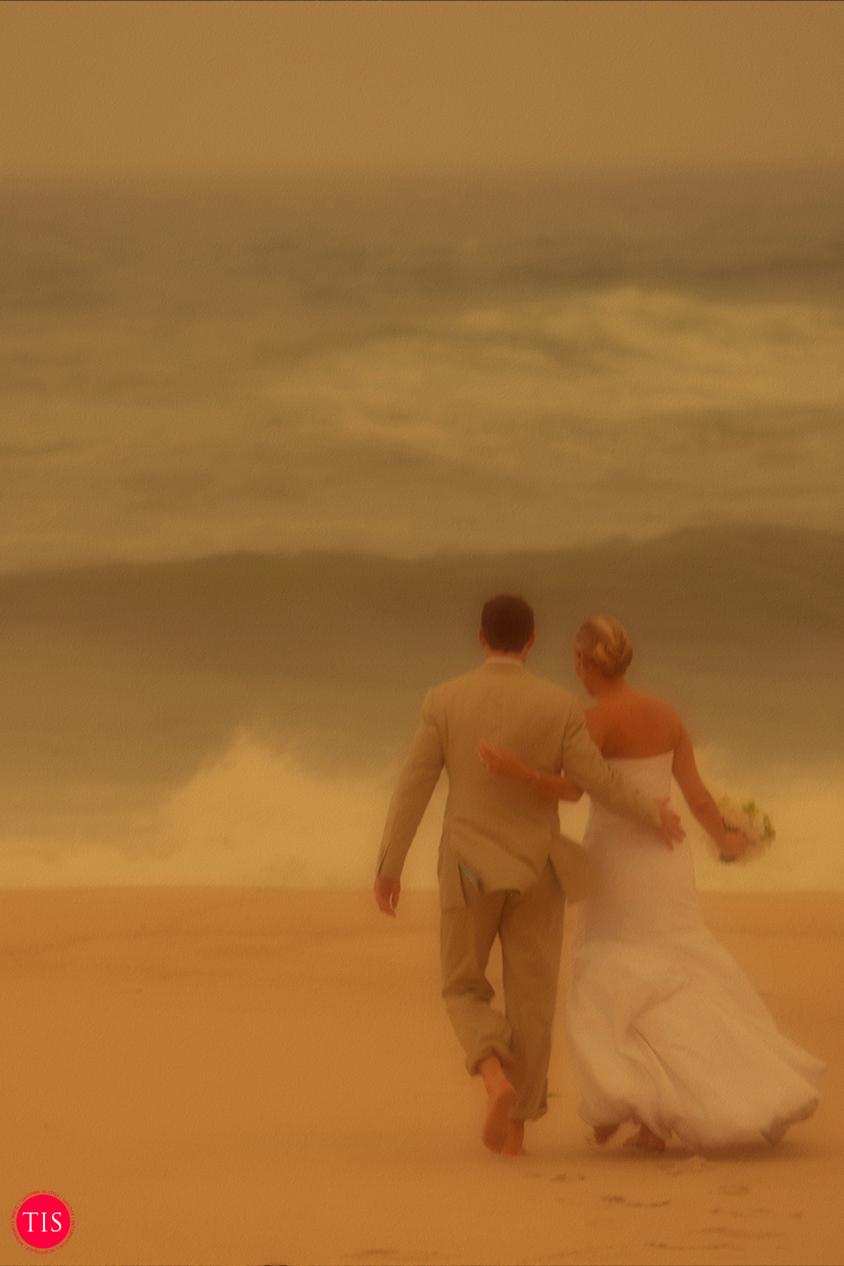 A newly wedded couple walks on the beach as they catch a break from a the rain as a hurricane heads towards their Hamptons Beach Wedding. Moment captured by  Maring Visuals