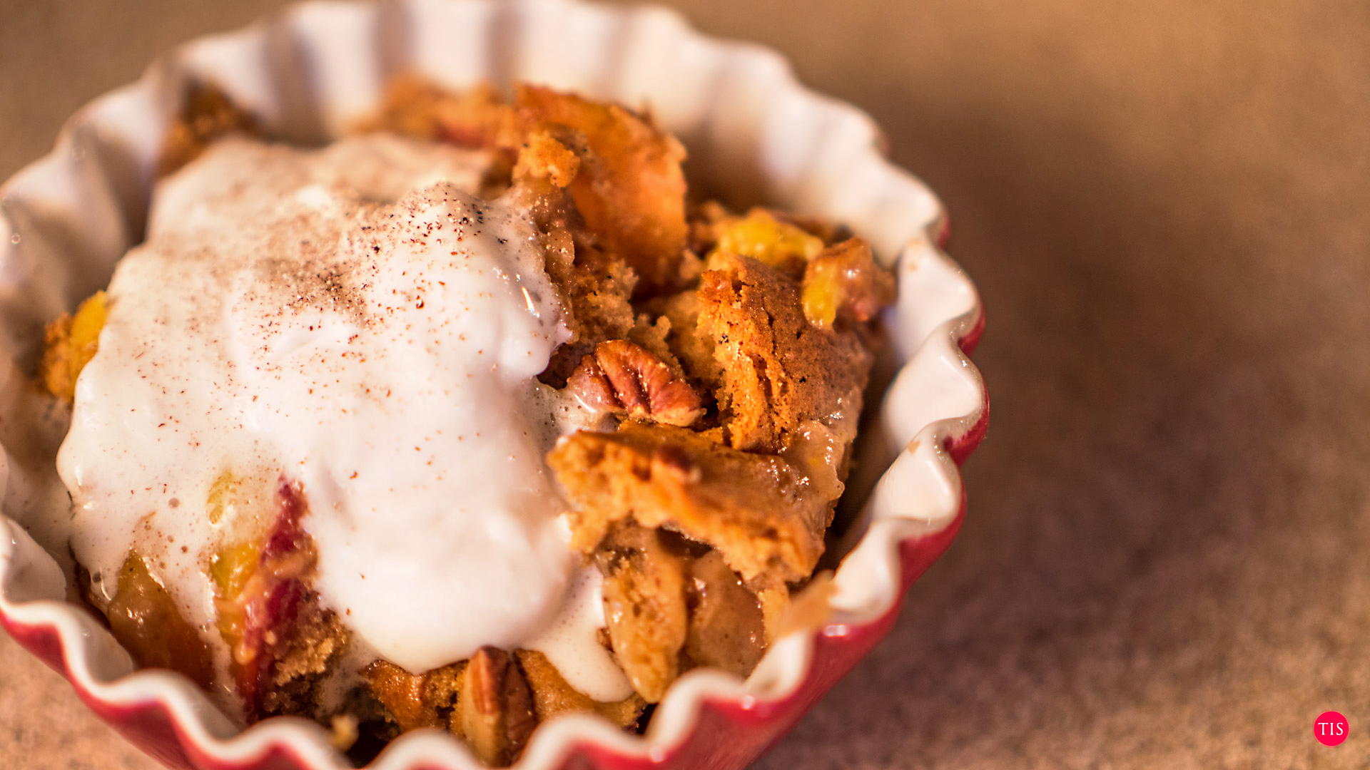 Jennifer Maring's Spiced Pecan Peach Cobbler recipe with coconut cream on top