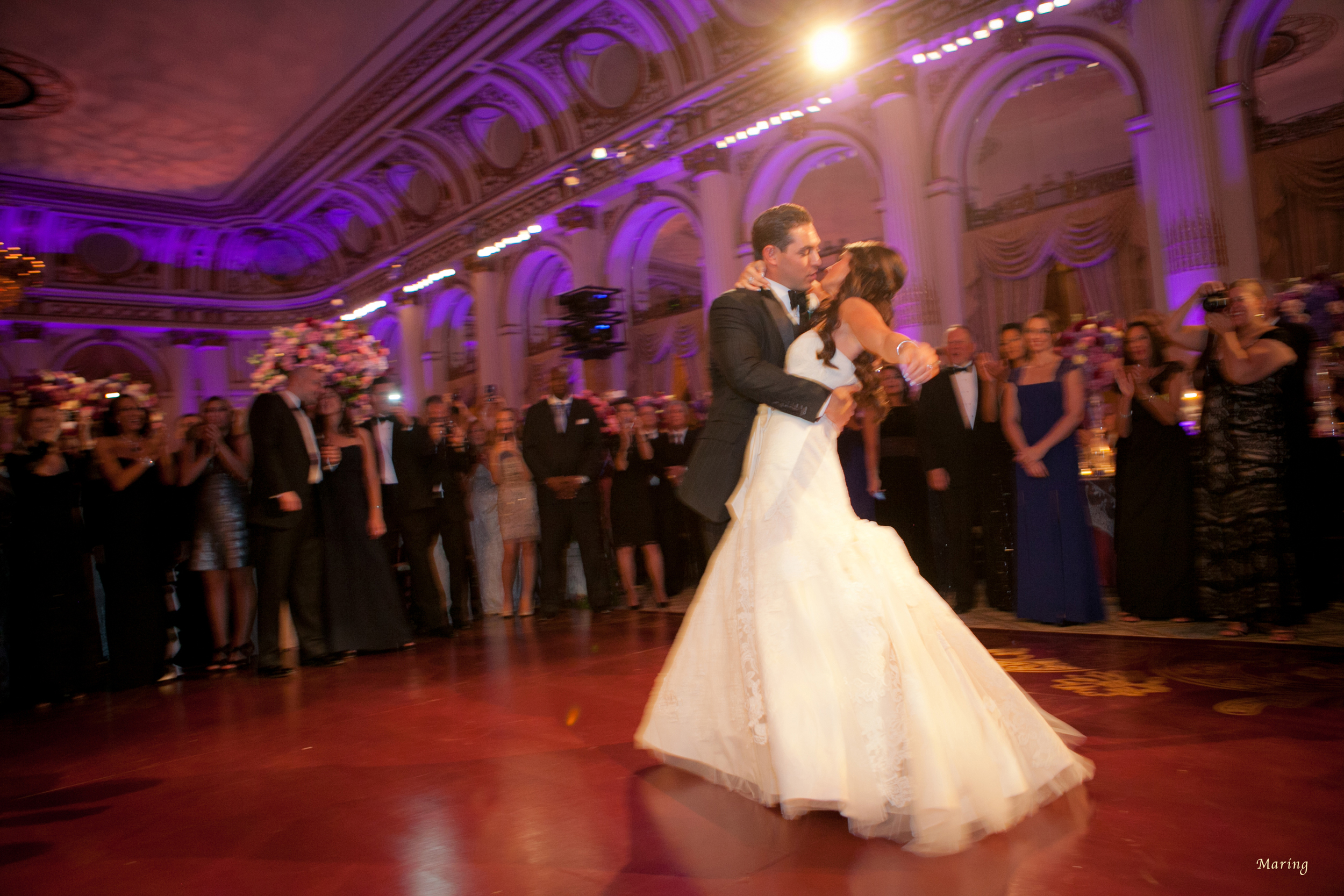 The bride and groom kiss at the end of their first dance as Maring captures the moment romantically during their  wedding at The Plaza Hotel , NYC. The couple came to Maring as a referral from celebrity wedding planner  David Tutera .