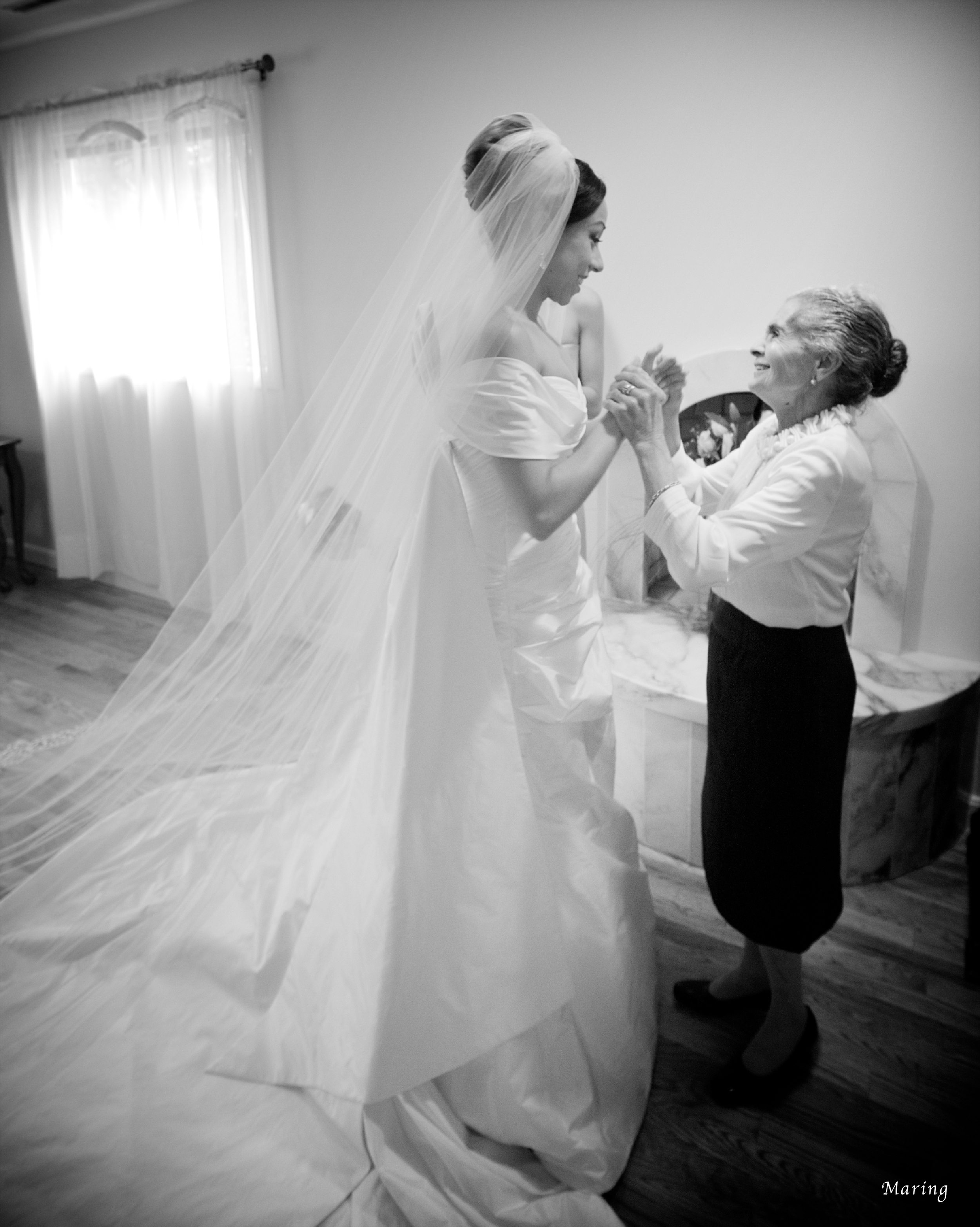 The grandmother of the bride shares a special moment with the bride after seeing her in the wedding dress for the first time. Moments like this only happen once in a lifetime, which is why it is so important to hire a photographer with a gifted eye for capturing meaningful moments.