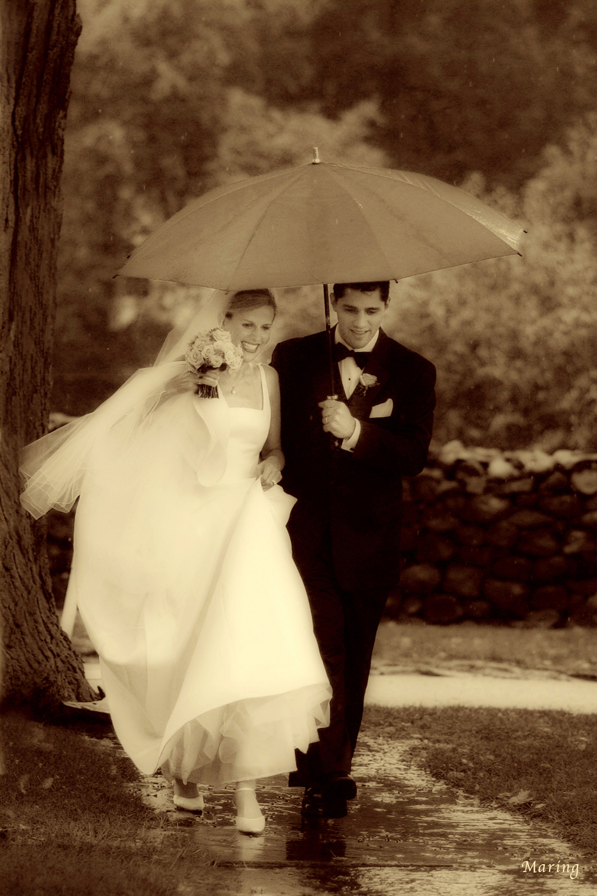Photographer Charles Maring doesn't let the rain get in the way of romance. Instead, he uses the weather to his advantage capturing moments that the couple would never want to trade for a sunny day.  Wedding at The Hillstead Museum in Connecticut.
