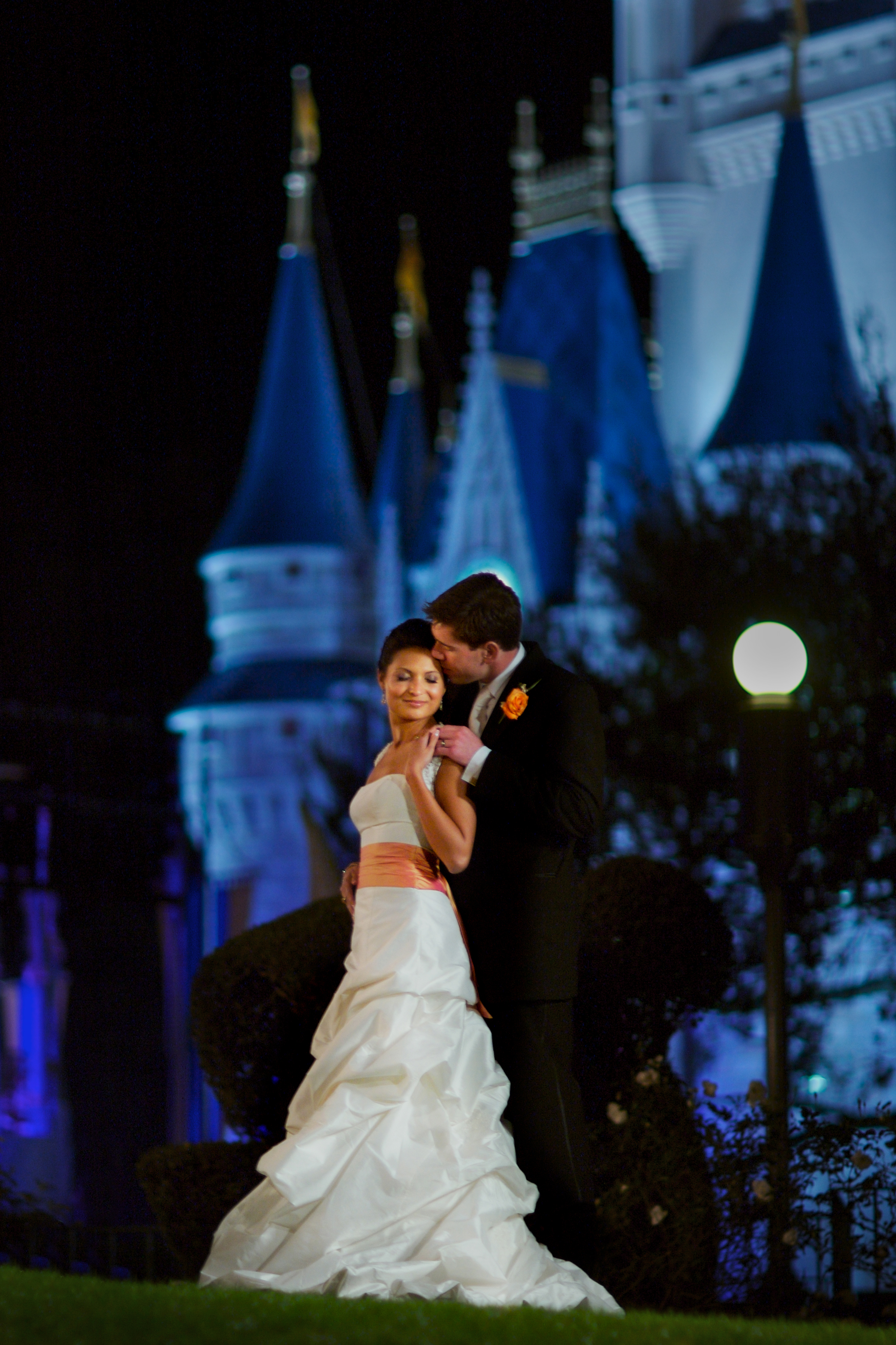 When  Disney Weddings , David Tutera , and  Bride's Magazine came to  Maring asking us to be on the Dream Team of wedding professionals and to capture a lavish wedding on the steps of the castle at Walt Disney World, we couldn't refuse! This beautiful portrait was created by Maring at night long after the park had closed.