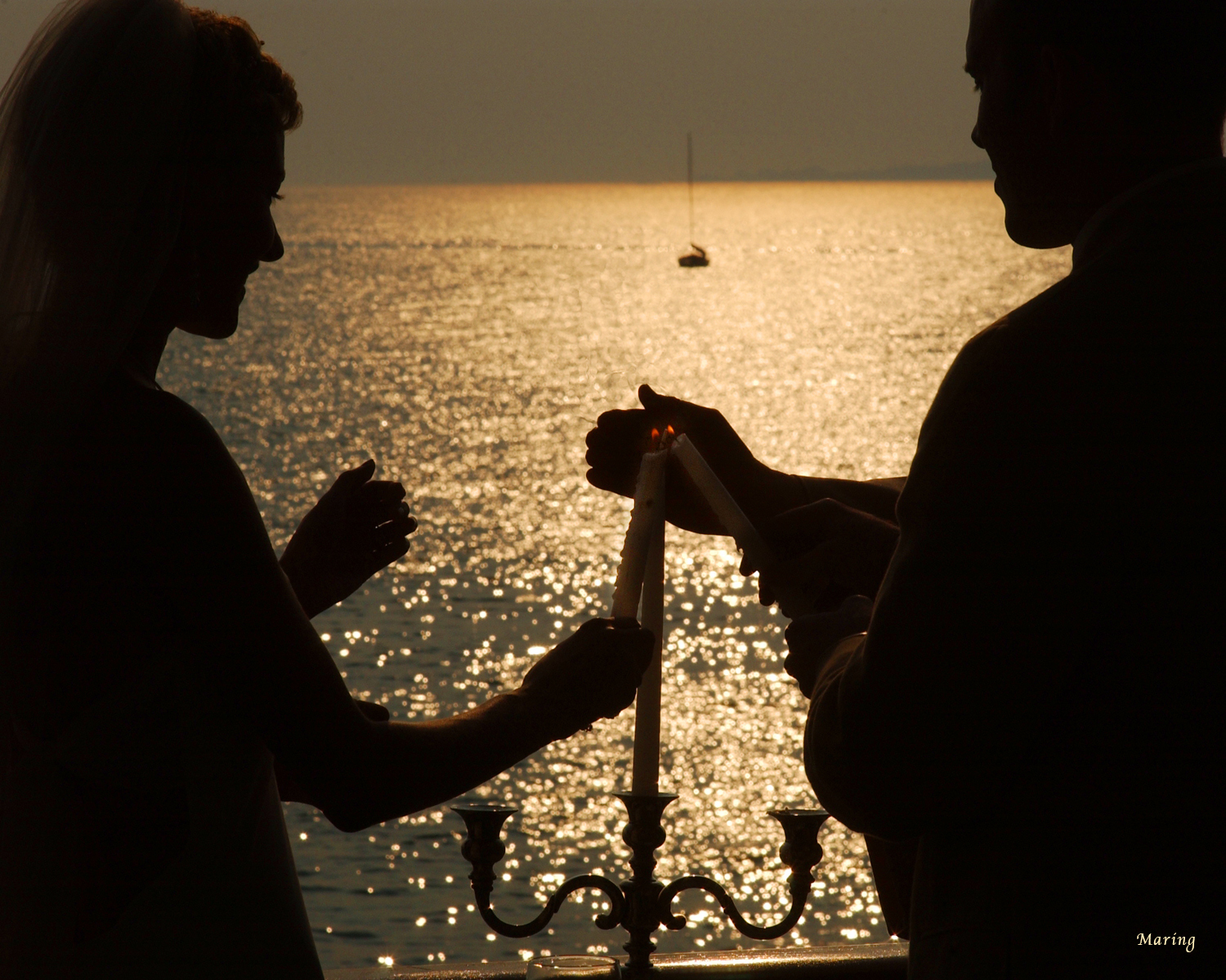 Silhouettes, candlight, and a sunset all gracing this beautiful ceremony, but also exposed for perfectly by photographer Charles Maring. No Photoshop is needed when you have a photographer that sees the world in a spectacular light.