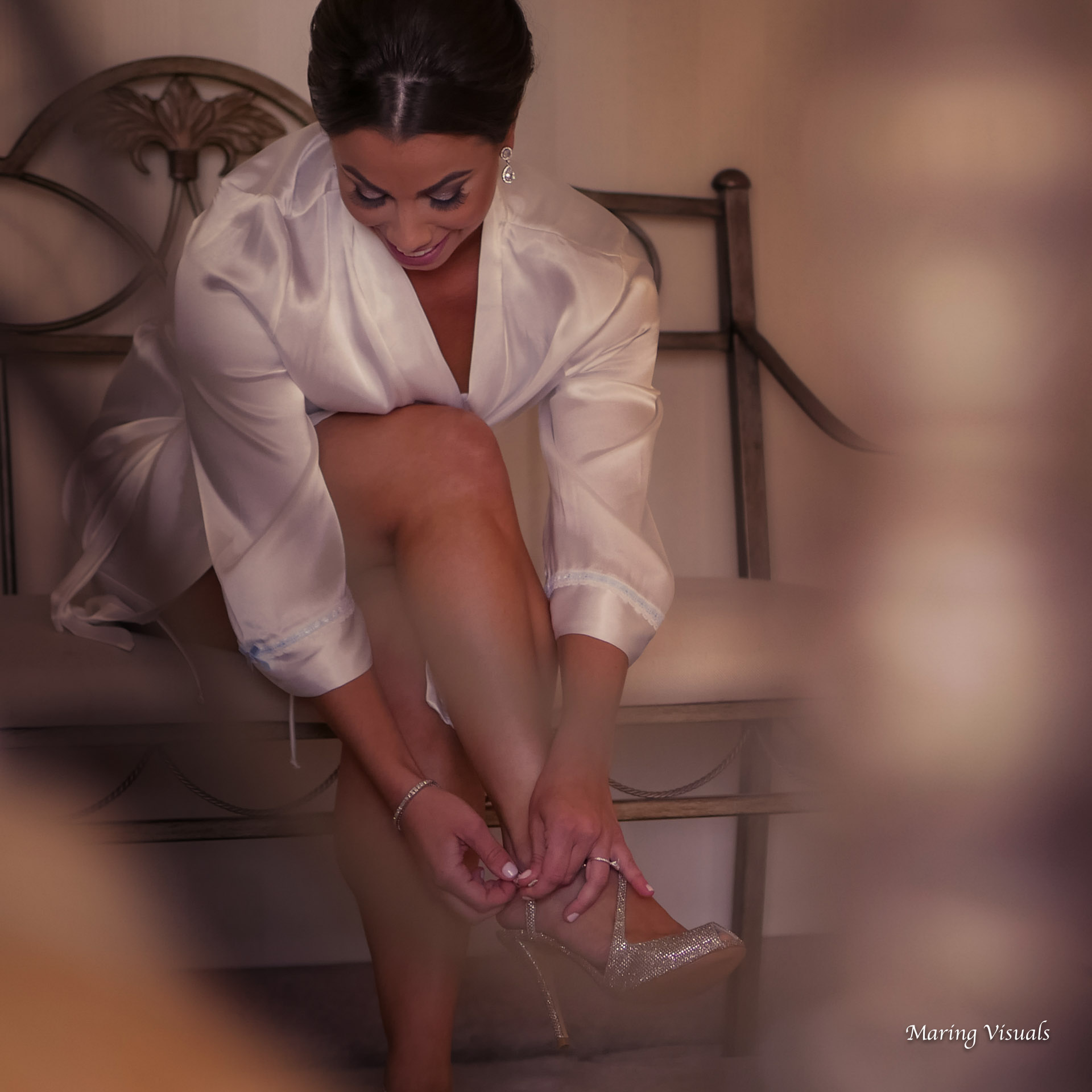 The Bride puts on her wedding shoes...