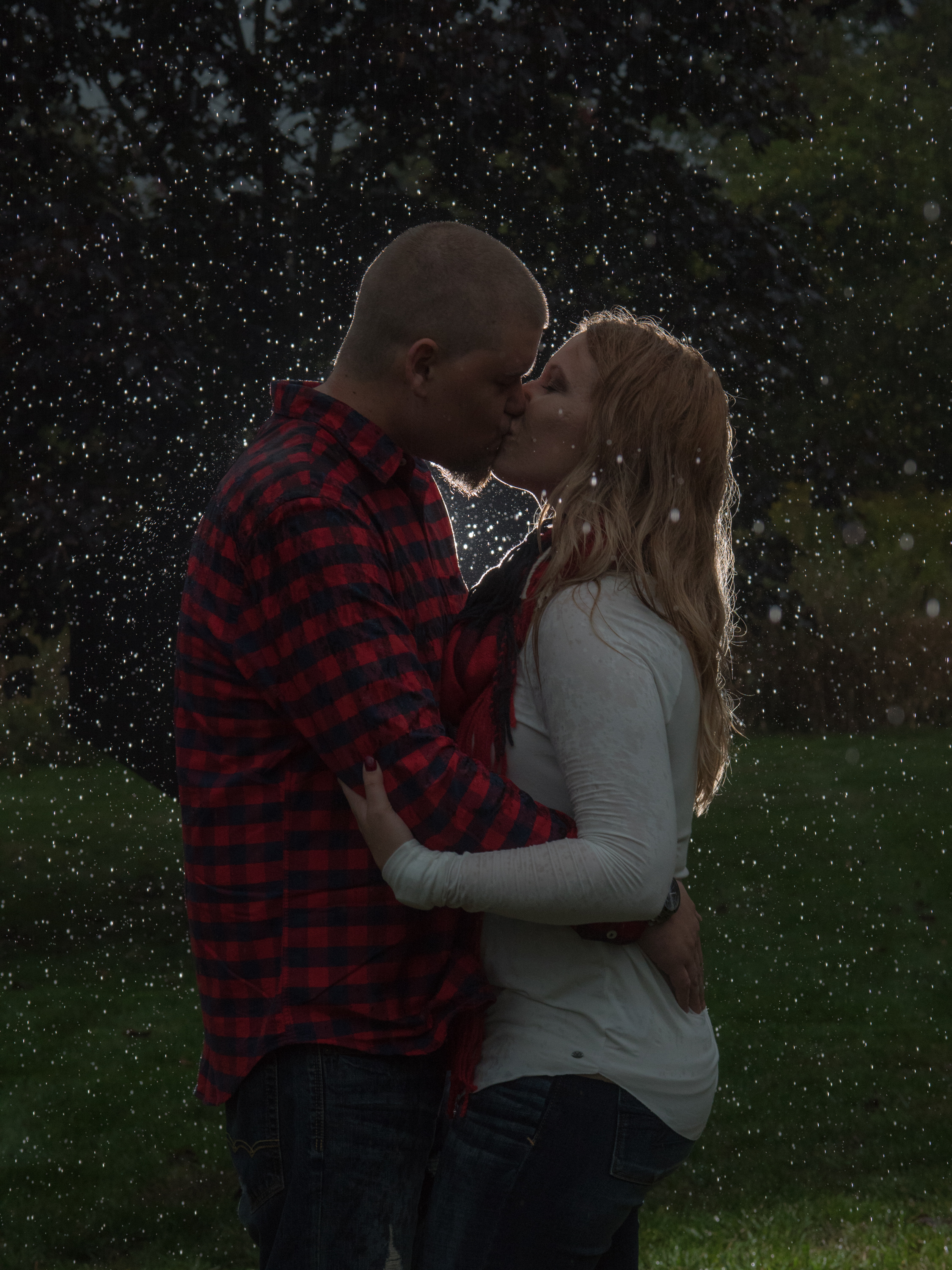 Engagement portraits in the rain