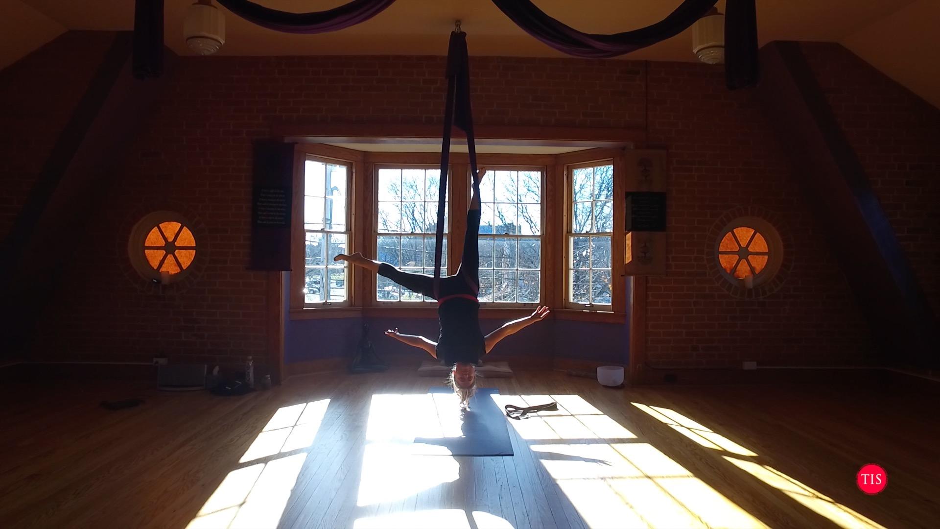 Jennifer Maring practicing aerial Yoga at Studio Ascend in North Haven