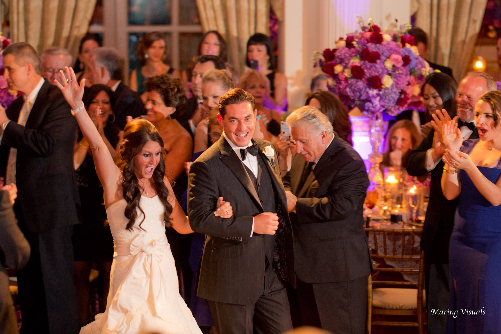 The Bride and Groom celebrate as they enter their reception at The Plaza Hotel NyC