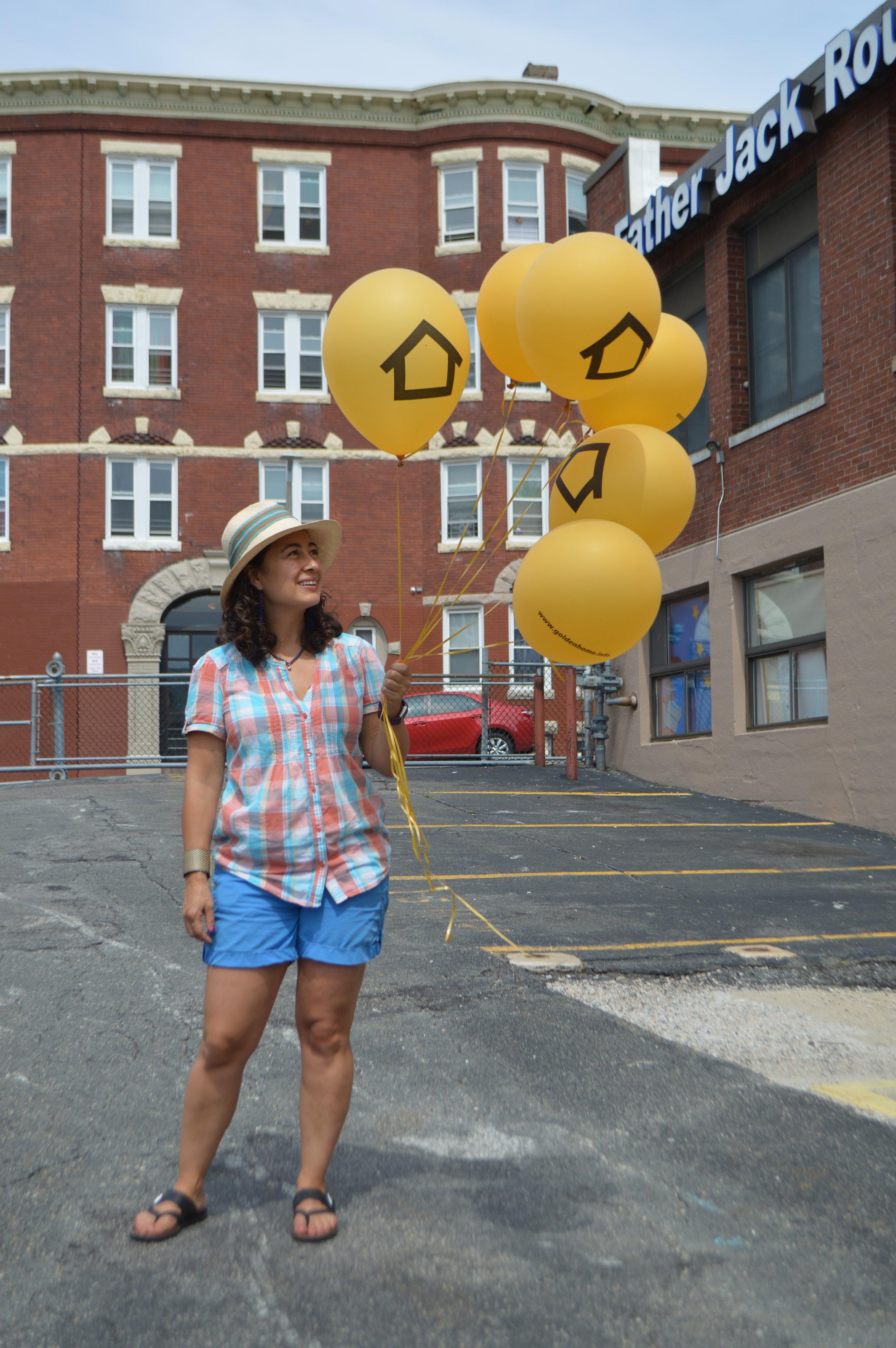 Lina and the  Golden Home  balloons. Photo credit Lina Maria Giraldo.