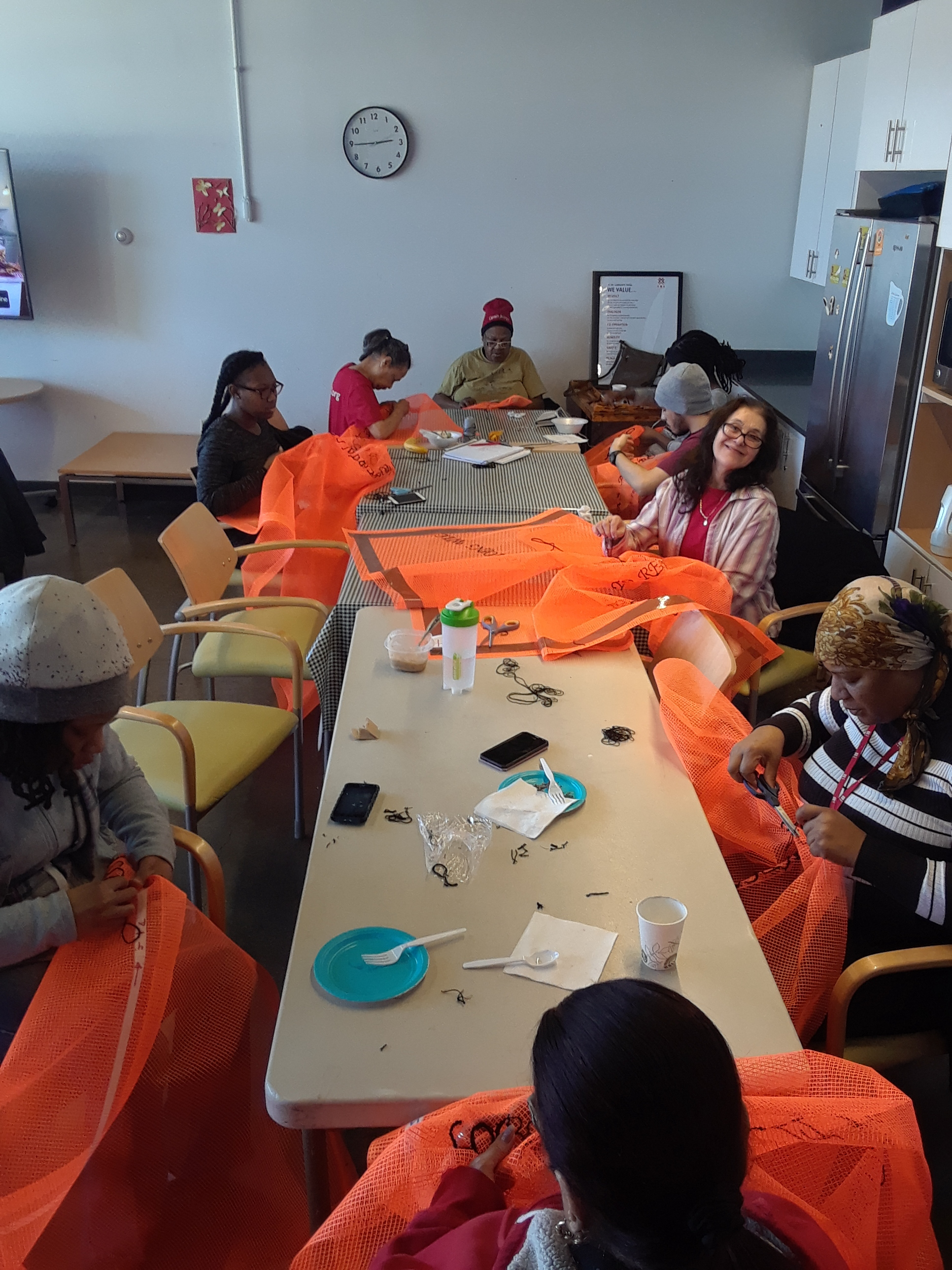 IBA/ UNLESS  community sewing event.