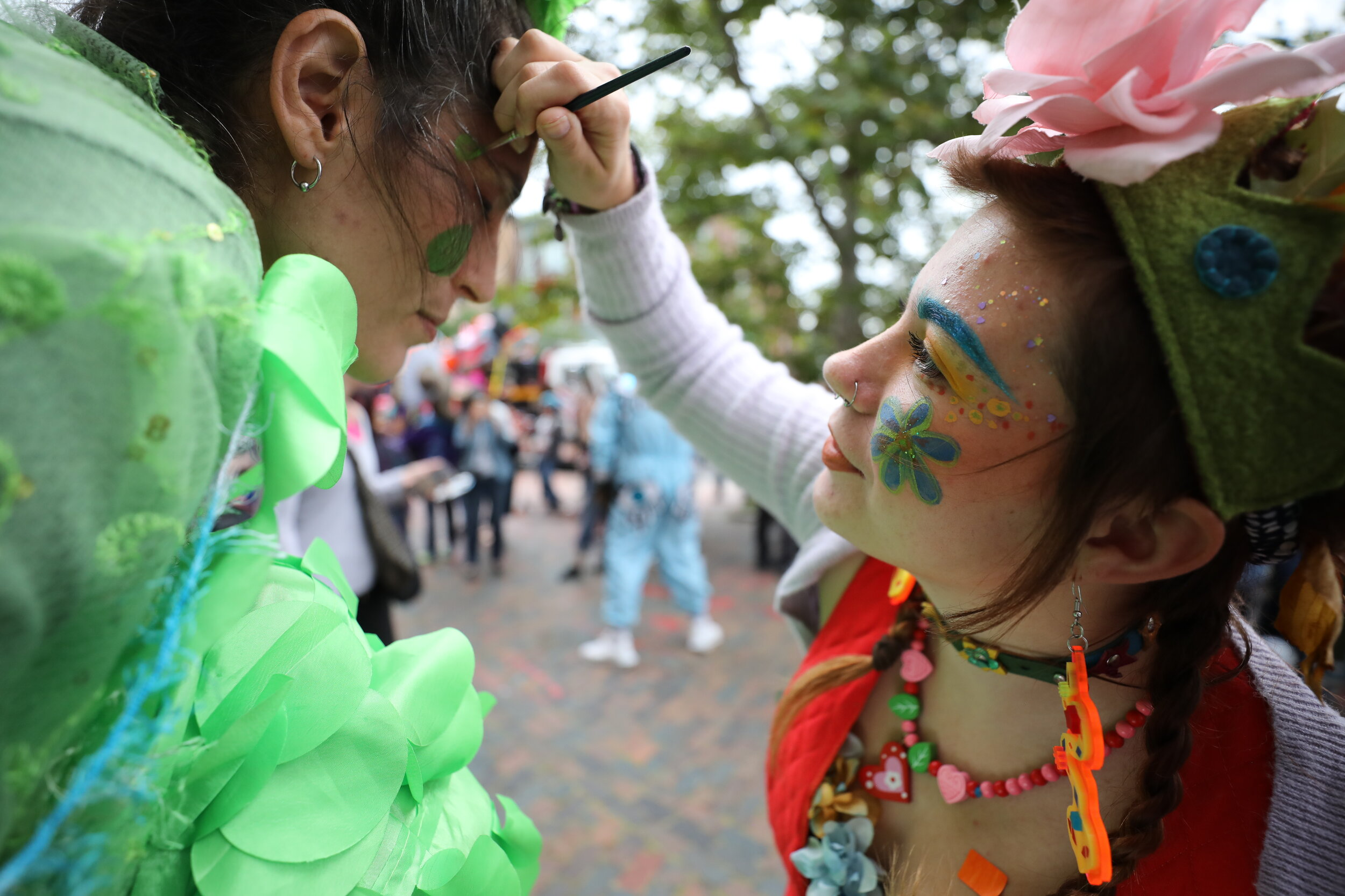Two performers get ready to launch the JOY Parade. Photo by Dominic Chavez