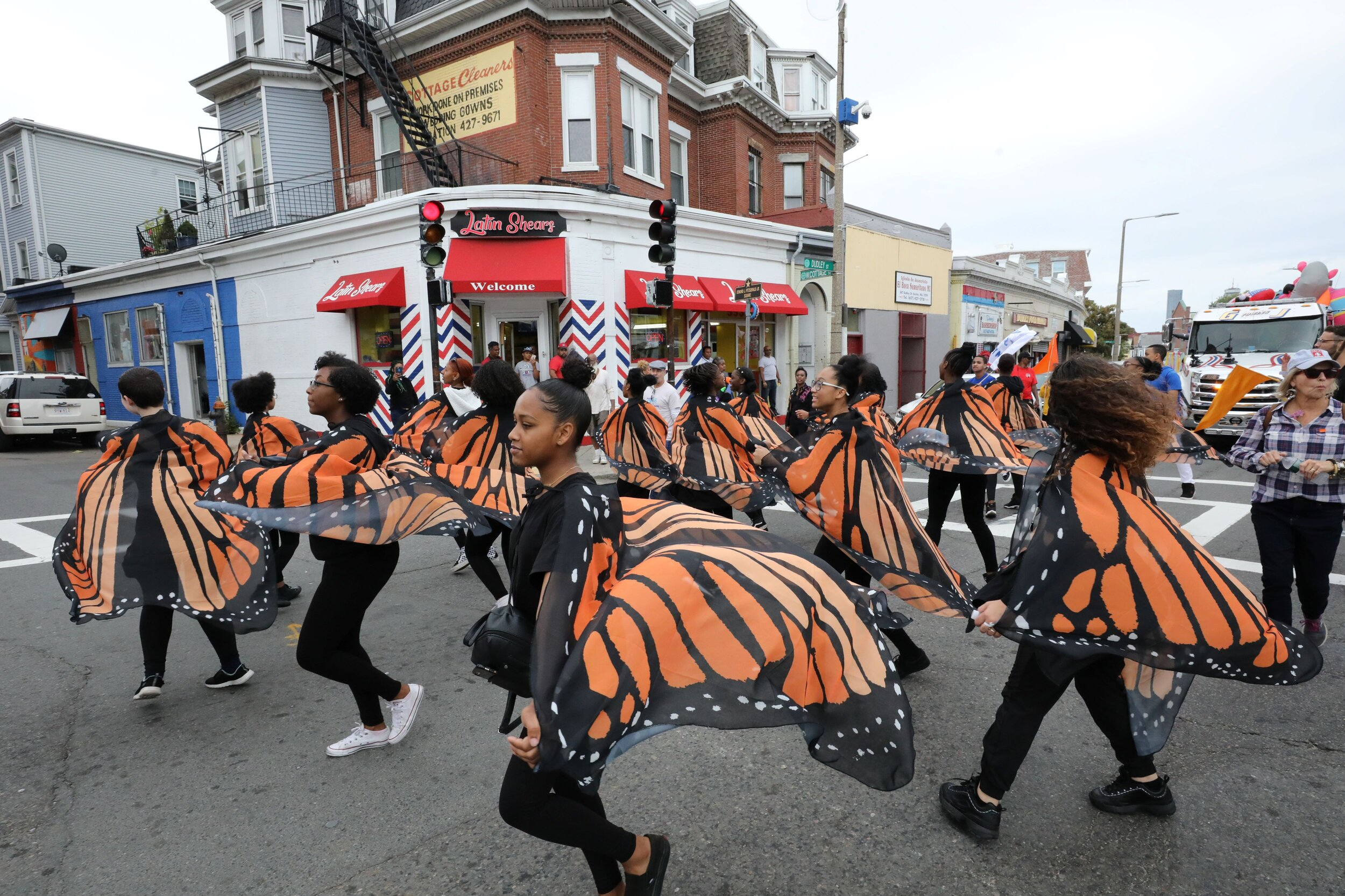 Butterfly Dancers from Boston Arts Academy dance through Dudley Square. Photo by Dominic Chavez