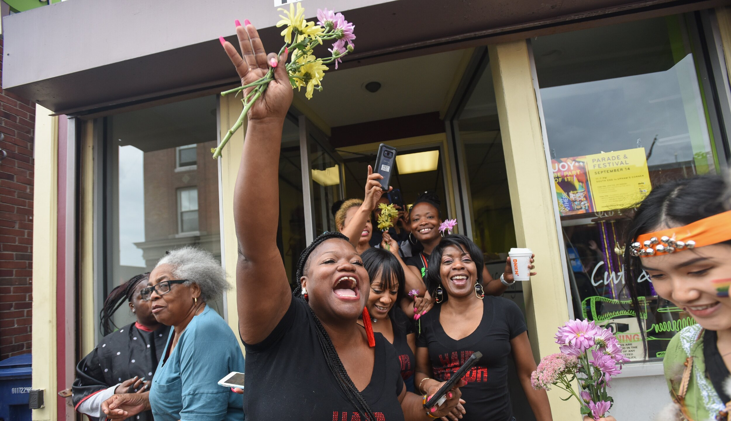 Cheering for art and joy in Dudley Square. Photo by Faith Ninivaggi