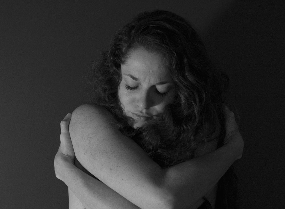When I get especially down, I'll give myself a hug. It may sound silly, but damn does it feel good. Showing yourself love through touch can be just as if not more effective than positive self-talk.