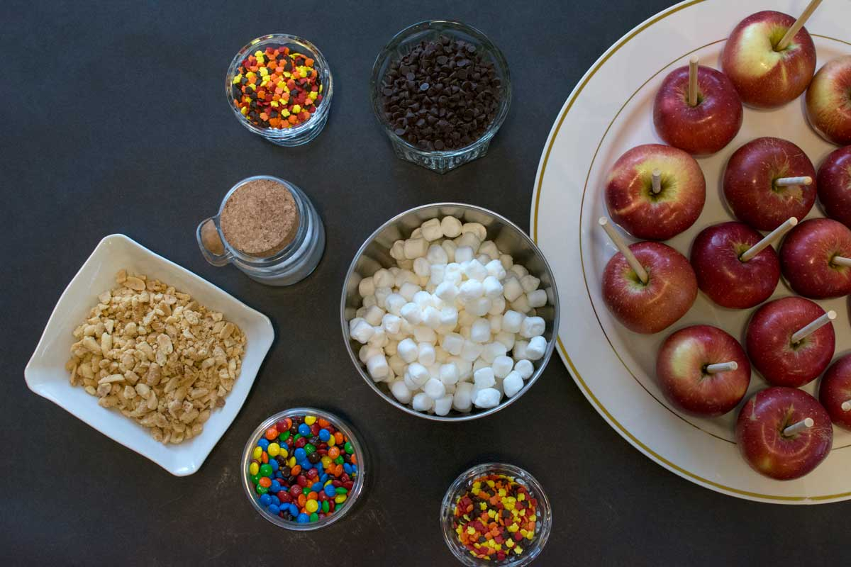 We had tons of toppings for our caramel apple making station, and even boxes for guests to take them home in!